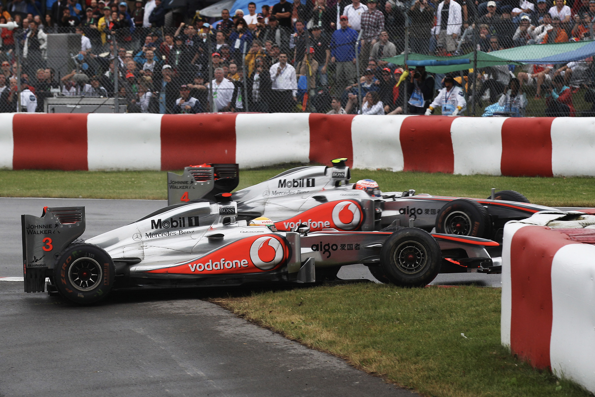 Jenson Button and Lewis Hamilton collide in the 2011 canadian grand prix