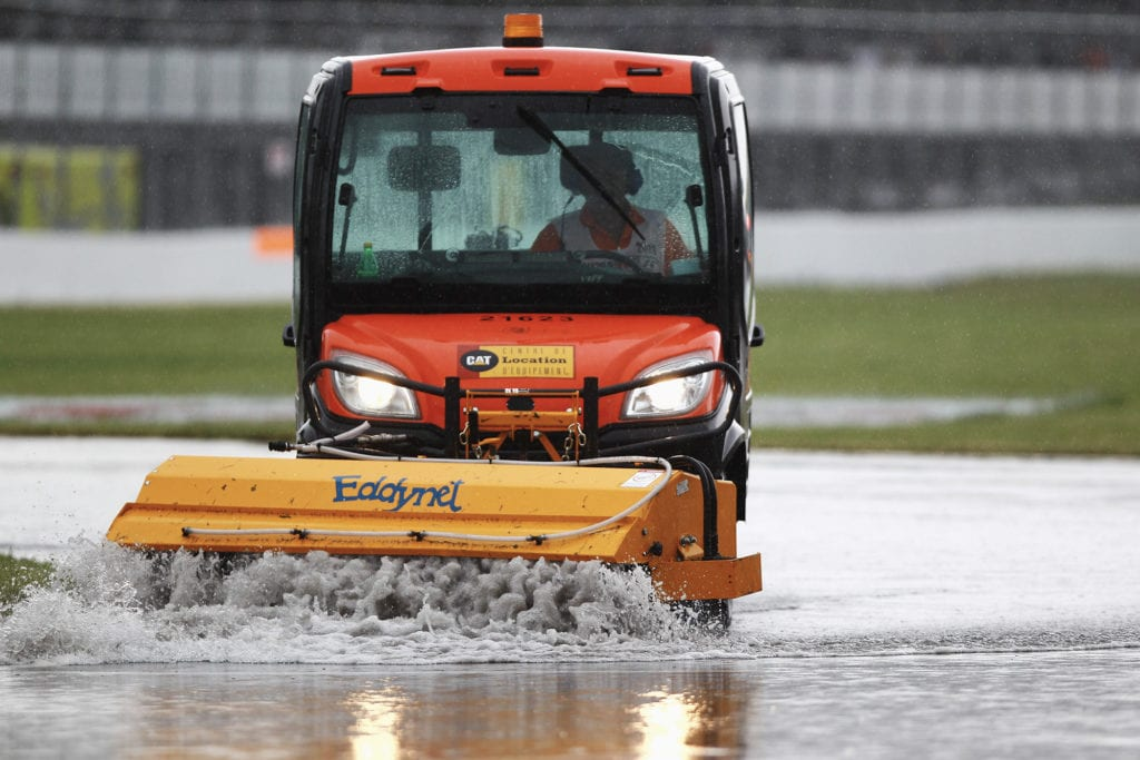 Water being cleared from the track while the 2011 canadian grand prix is stopped