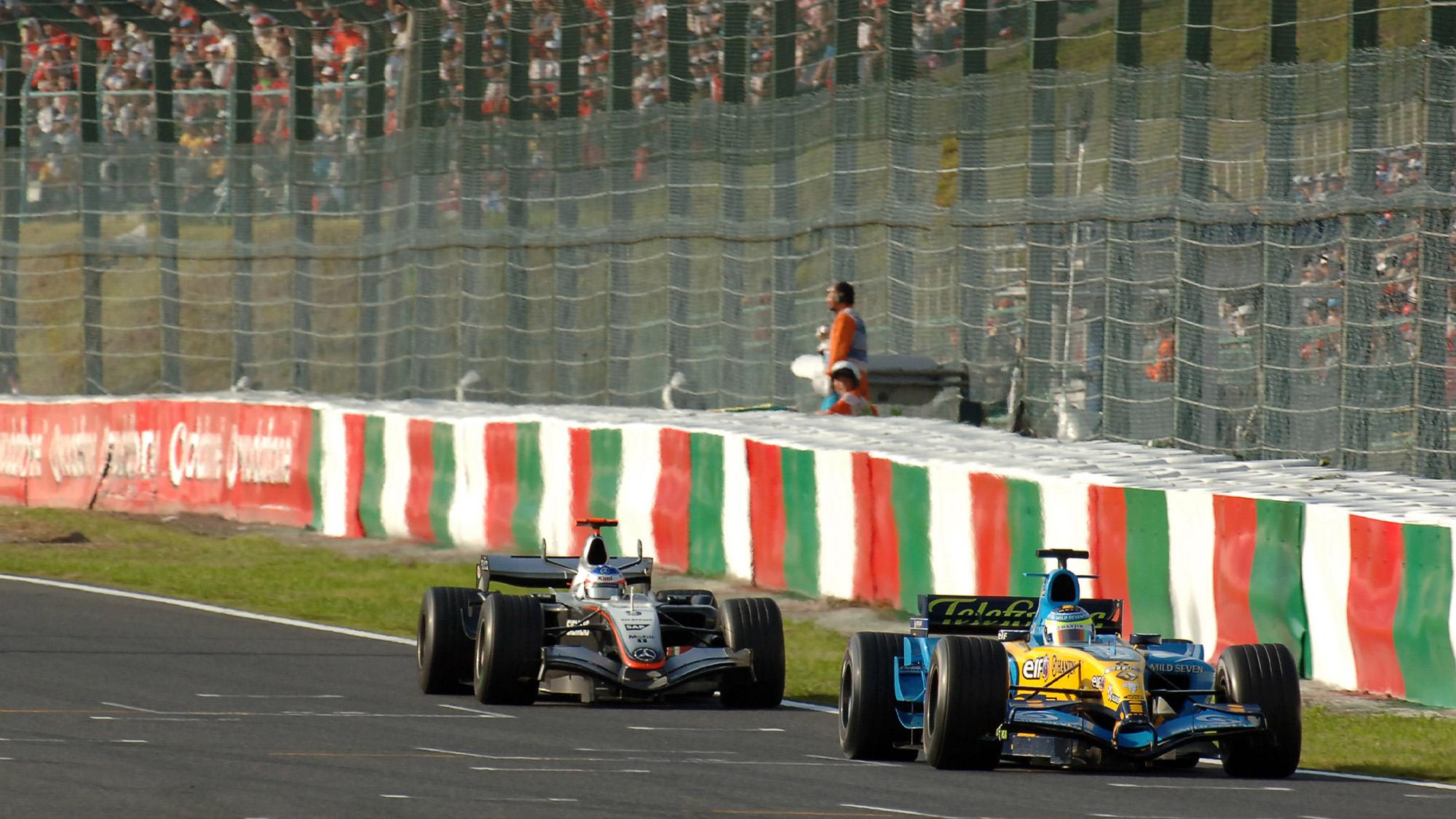 Kimi Raikkonen follows Giancarlo Fisichella in the Benetton during the 2005 Japanese Grand Prix at Suzuka