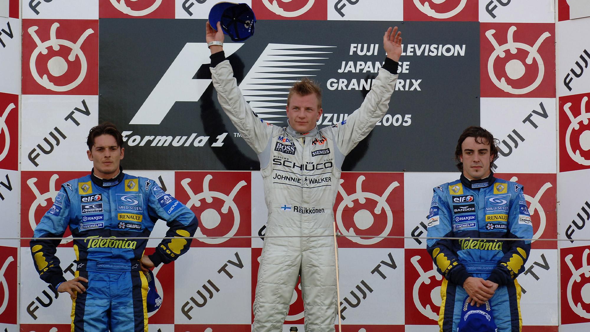 Kimi Raikkonen on the podium alongside Giancarlo Fisichella and Fernando Alonso after winning the 2005 F1 Japanese Grand prix at Suzuka