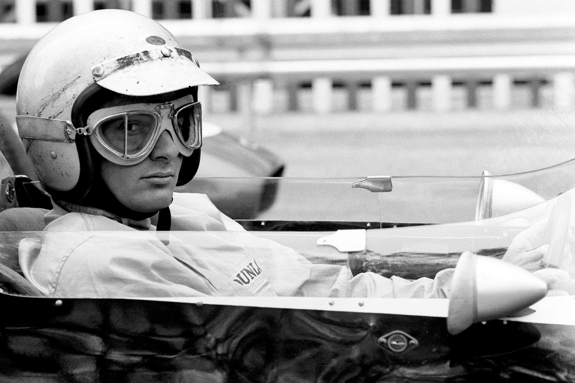 Bruce McLaren looks sideways ahead of the 1962 Monaco Grand Prix