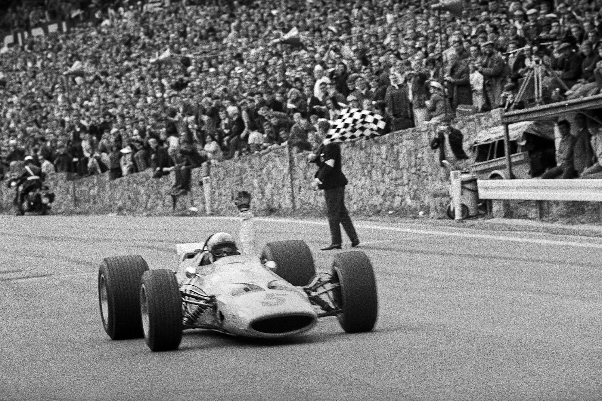 Bruce McLaren crosses the line to win the 1968 Belgian Grand Prix