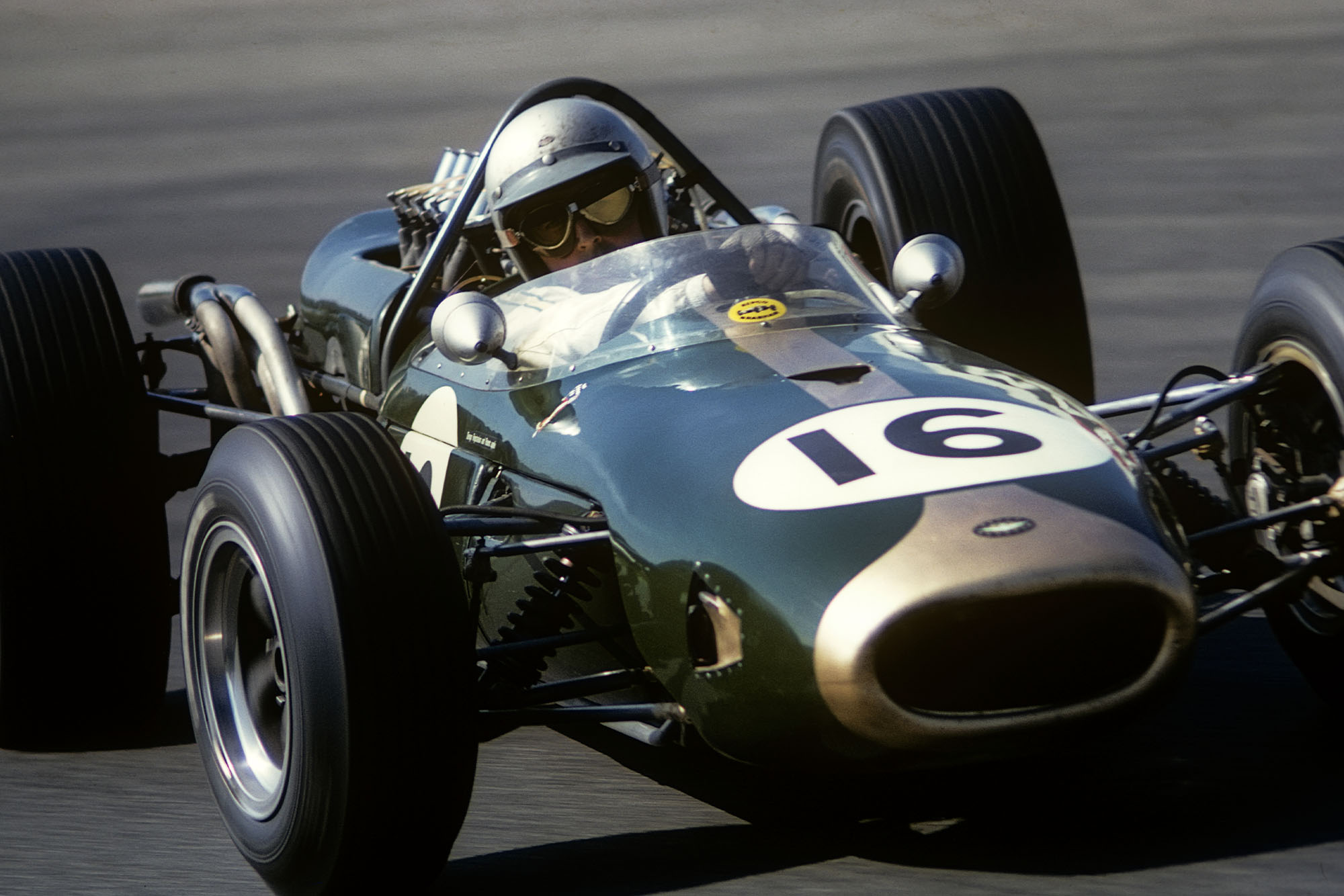 Jack Brabham, Brabham-Repco BT19, Grand Prix of the Netherlands, Circuit Park Zandvoort, 24 July 1966. A magnificent four wheel drift for Jack Brabham in the famous Tarzan curve on the Zandvoort circuit during the 1966 Grand Prix of Netherlands. (Photo by Bernard Cahier/Getty Images)