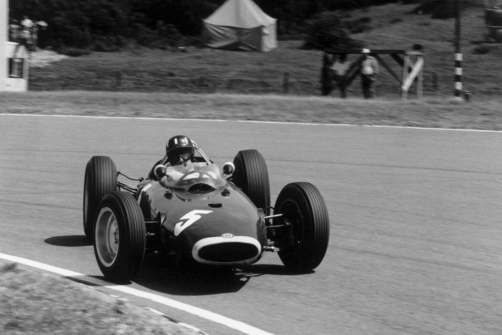 Graham Hill (BRM P57), goes sideways for photographer Michael Tee