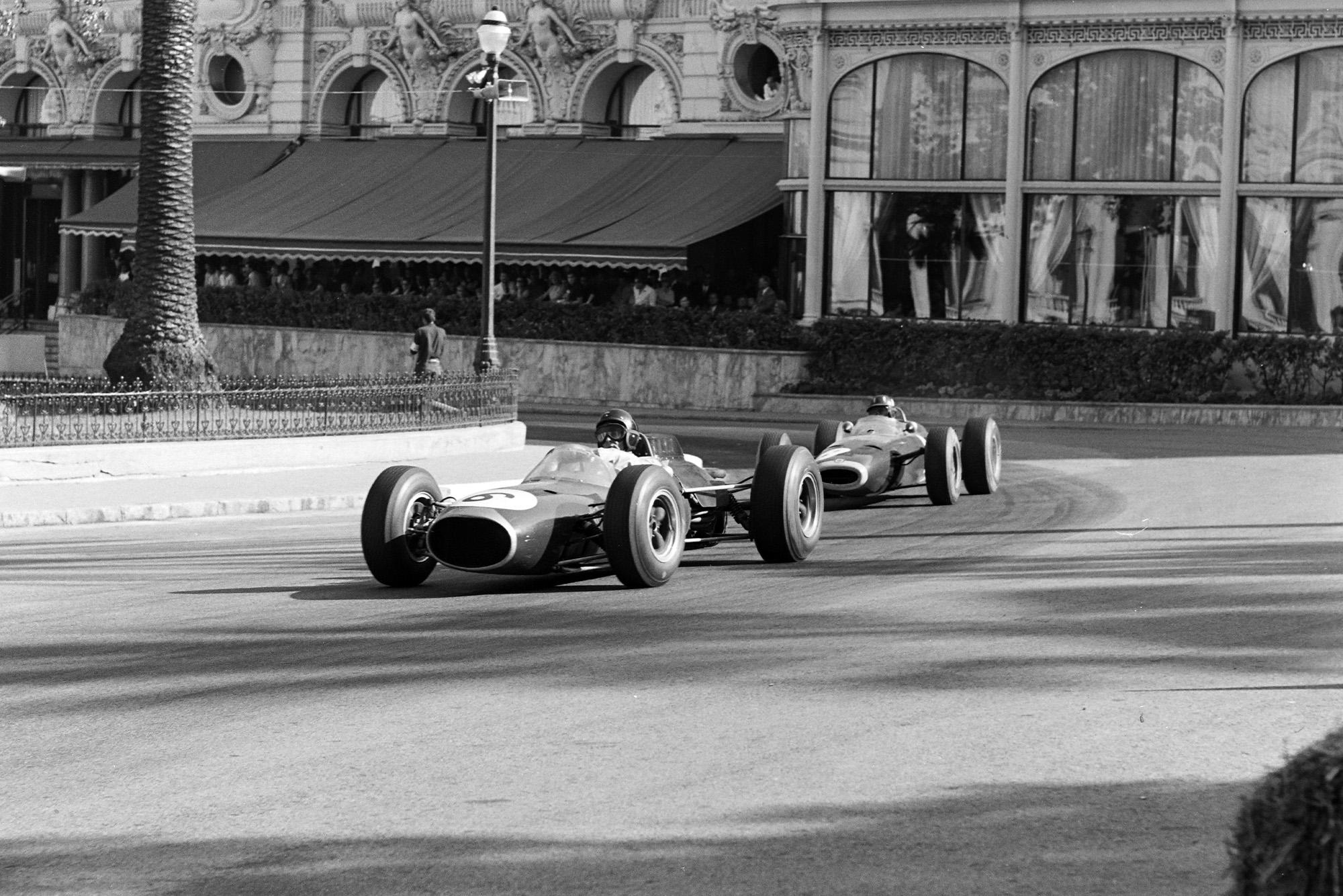 Dan Gurney, Brabham BT7 Climax, leads Graham Hill, BRM P261.