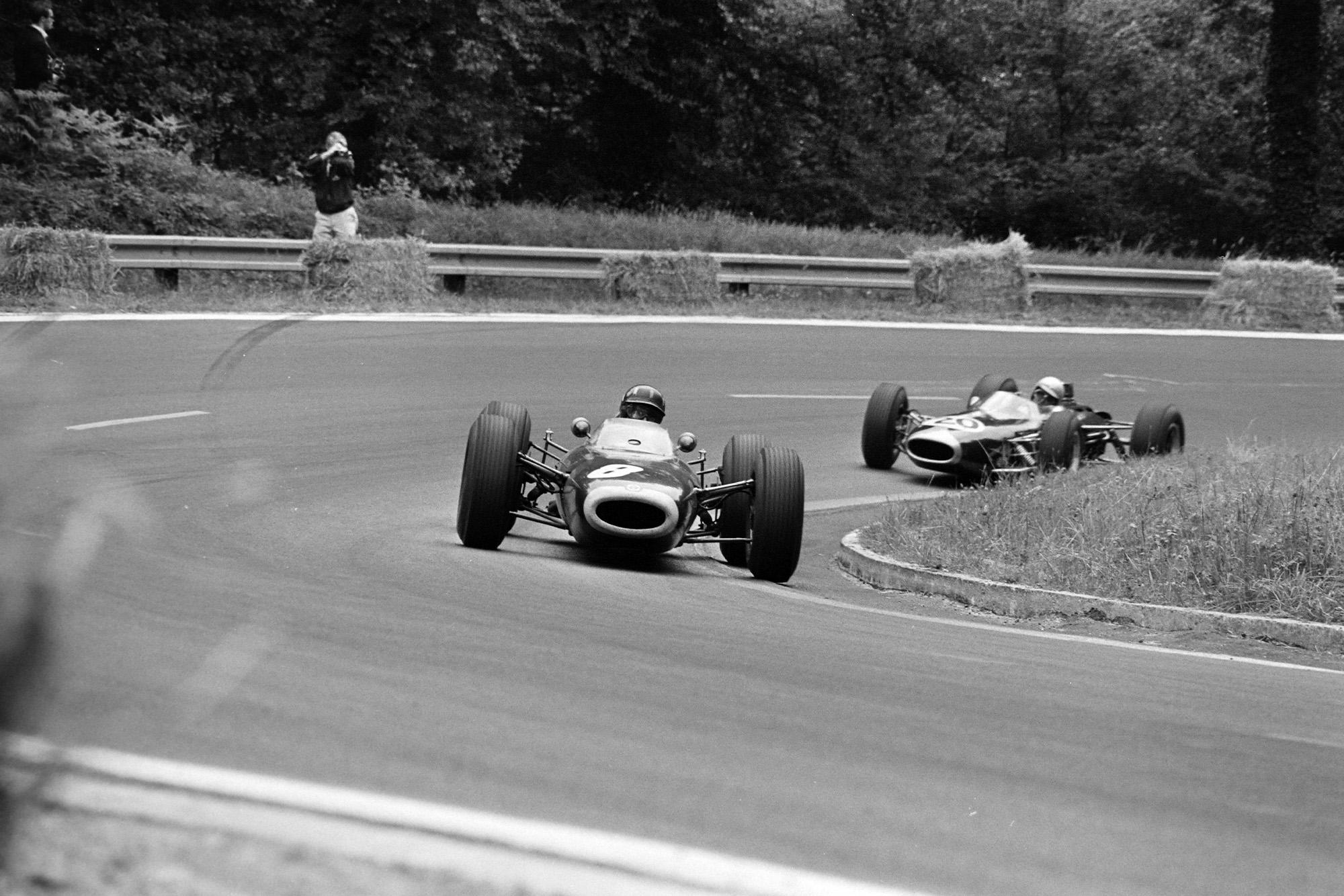 Graham Hill, BRM P261, leads Jack Brabham, Brabham BT7 Climax.