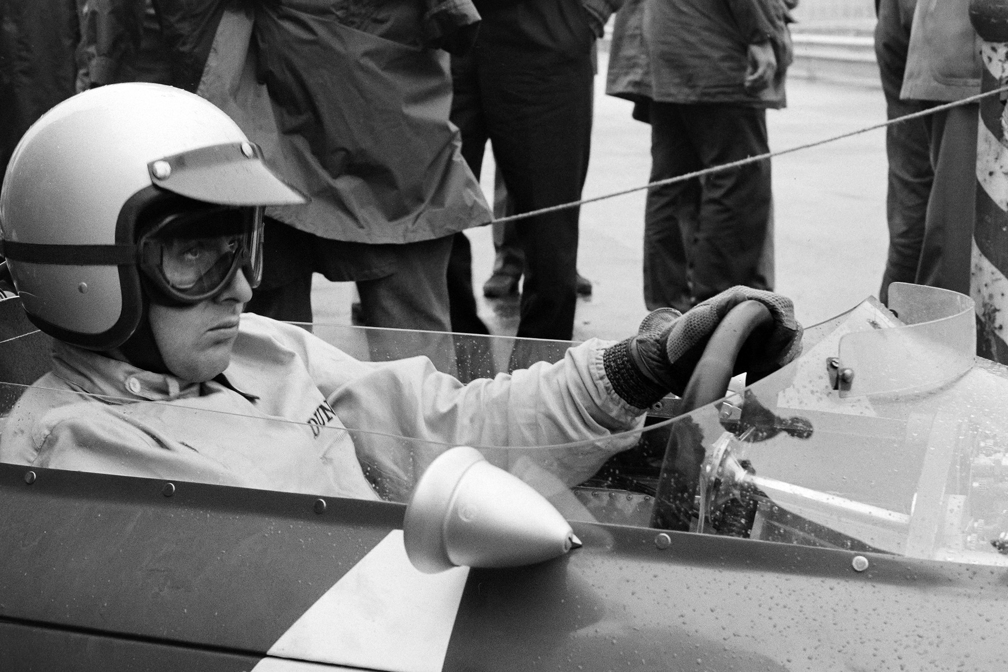 Ferrari's Lorenzo Bandini prepares for the race start.