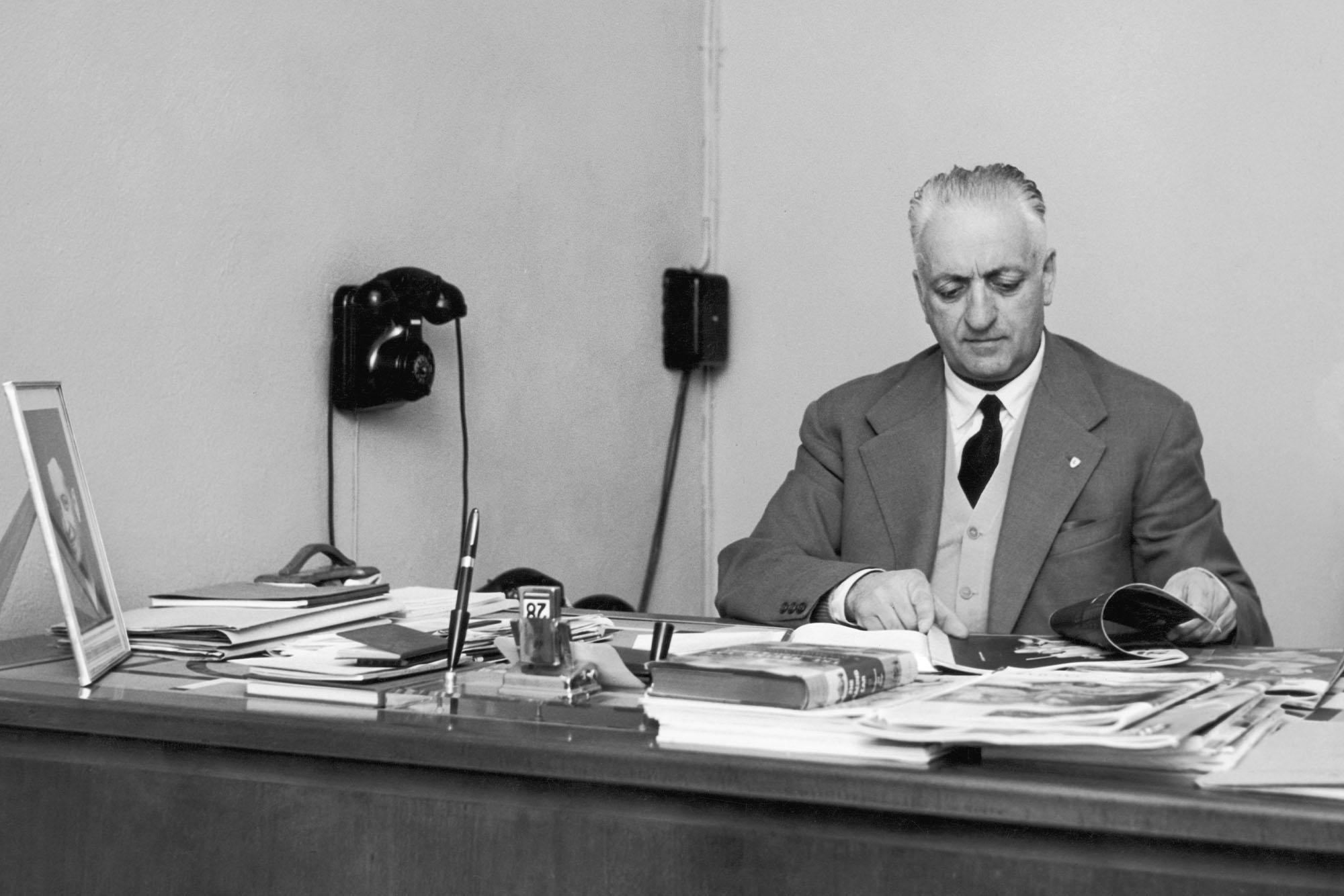 Italian car manufacturer Enzo Ferrari (1898 - 1988) at his desk, circa 1955. (Photo by Keystone/Hulton Archive/Getty Images)