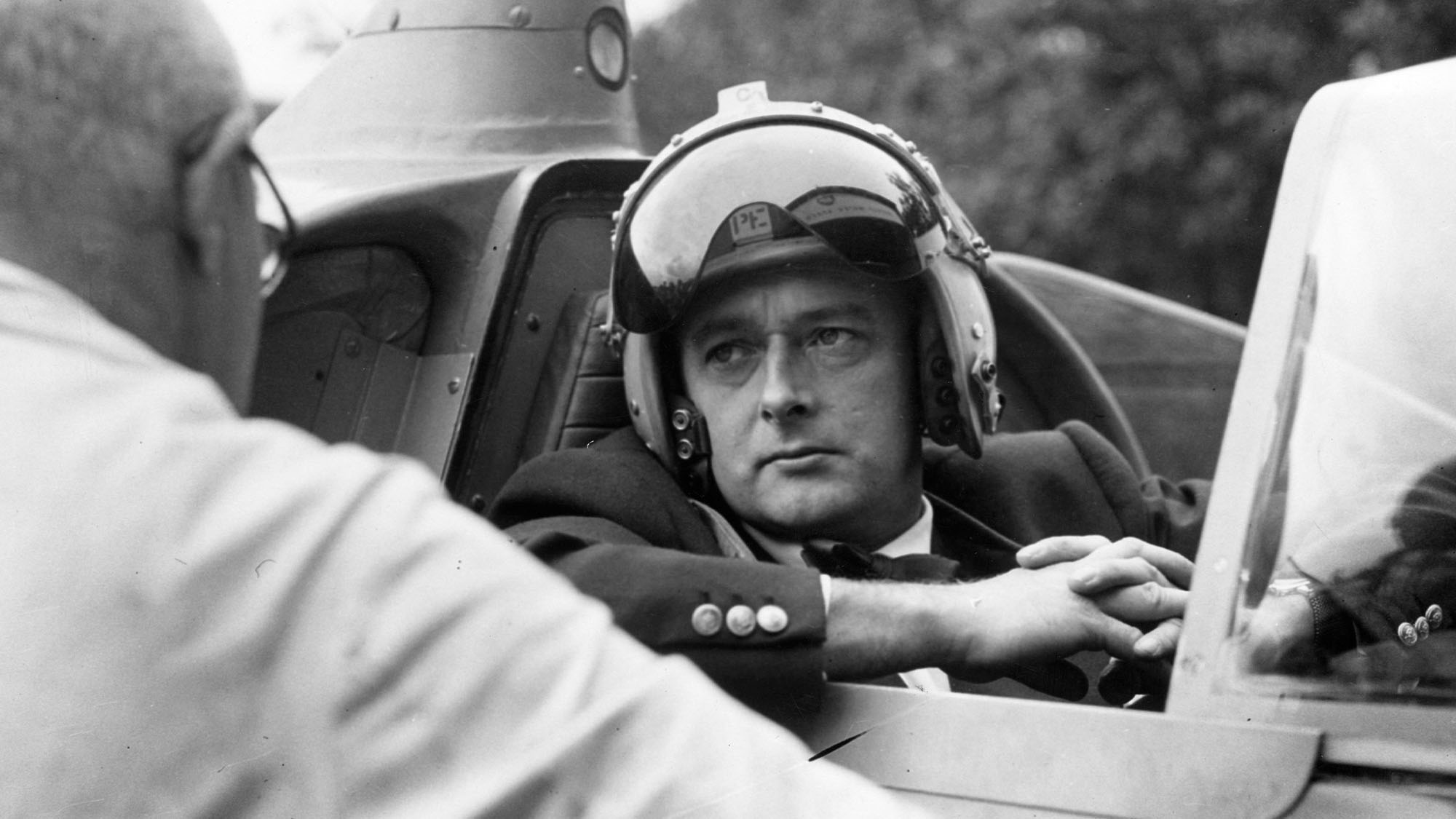 24th September 1958: Donald Campbell (1921 - 1967) in his jet hydroplane 'Bluebird' having a talk with his veteran mechanic Leo Villa. He is to attempt to break the water speed record on Coniston Water in the Lake District.