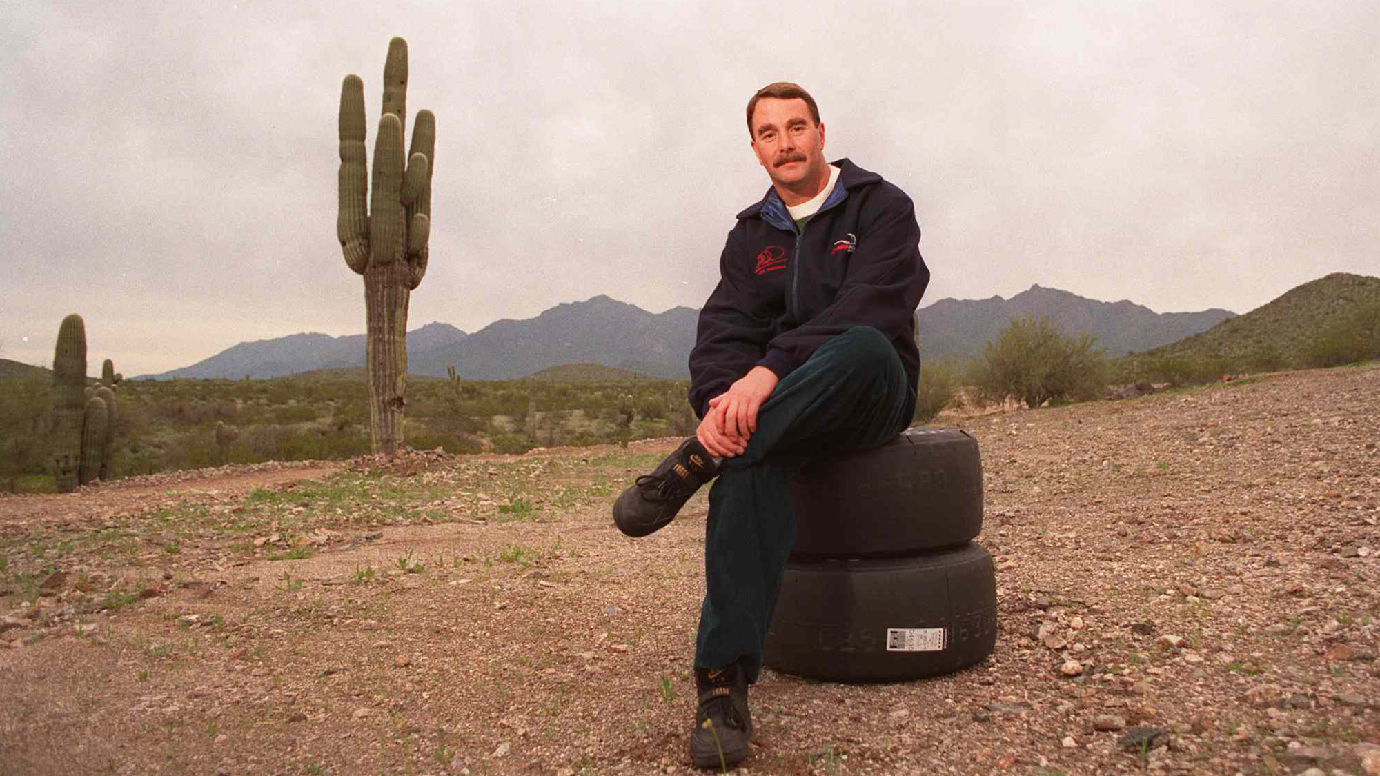 Nigel Mansell Formula One Racing Champion Now Indy Driver Sitting In Arizona Desert February 1993- (Photo By Paul Harris/Getty Images)
