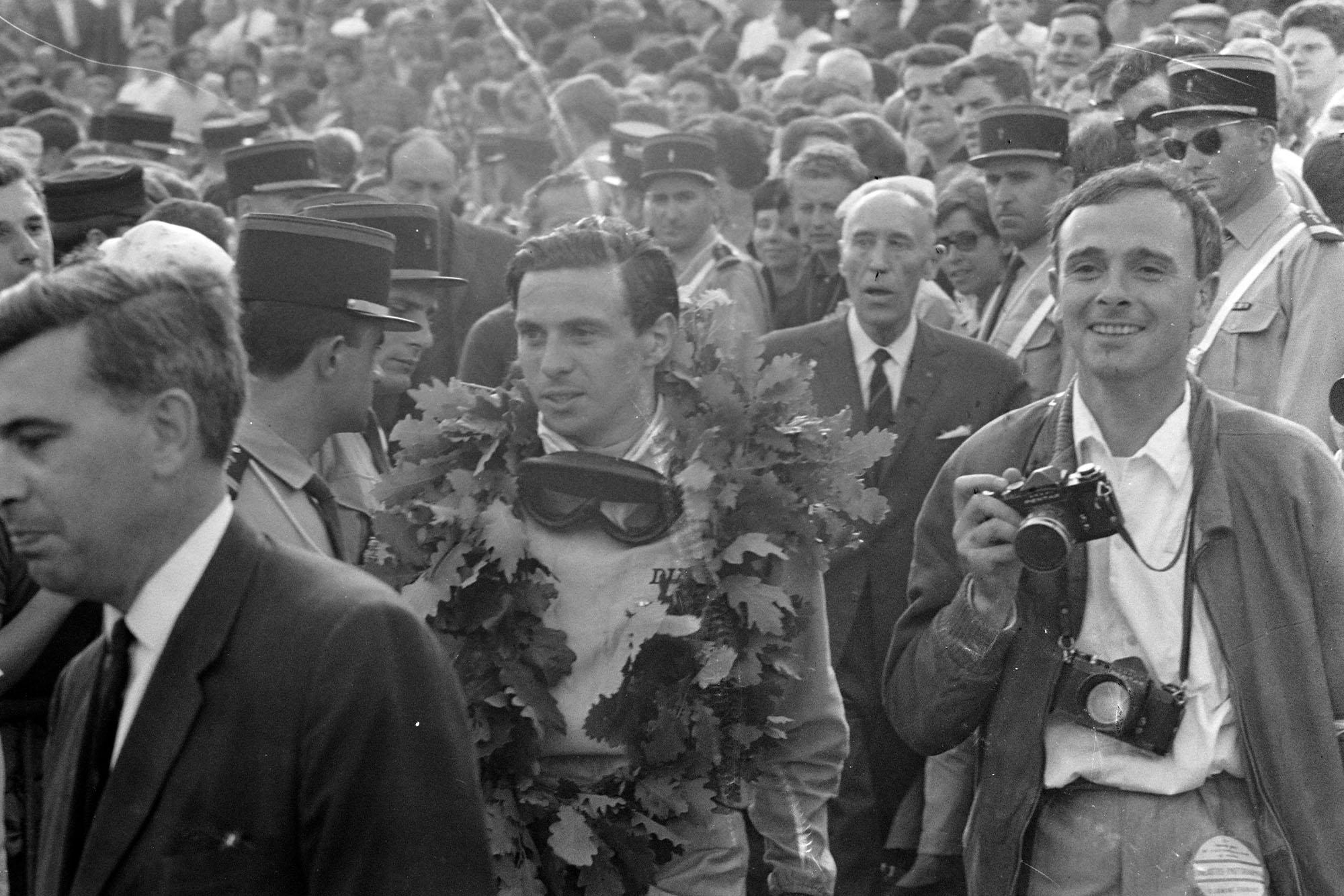 Jim Clark, 1st position, with his race winner's wreath.