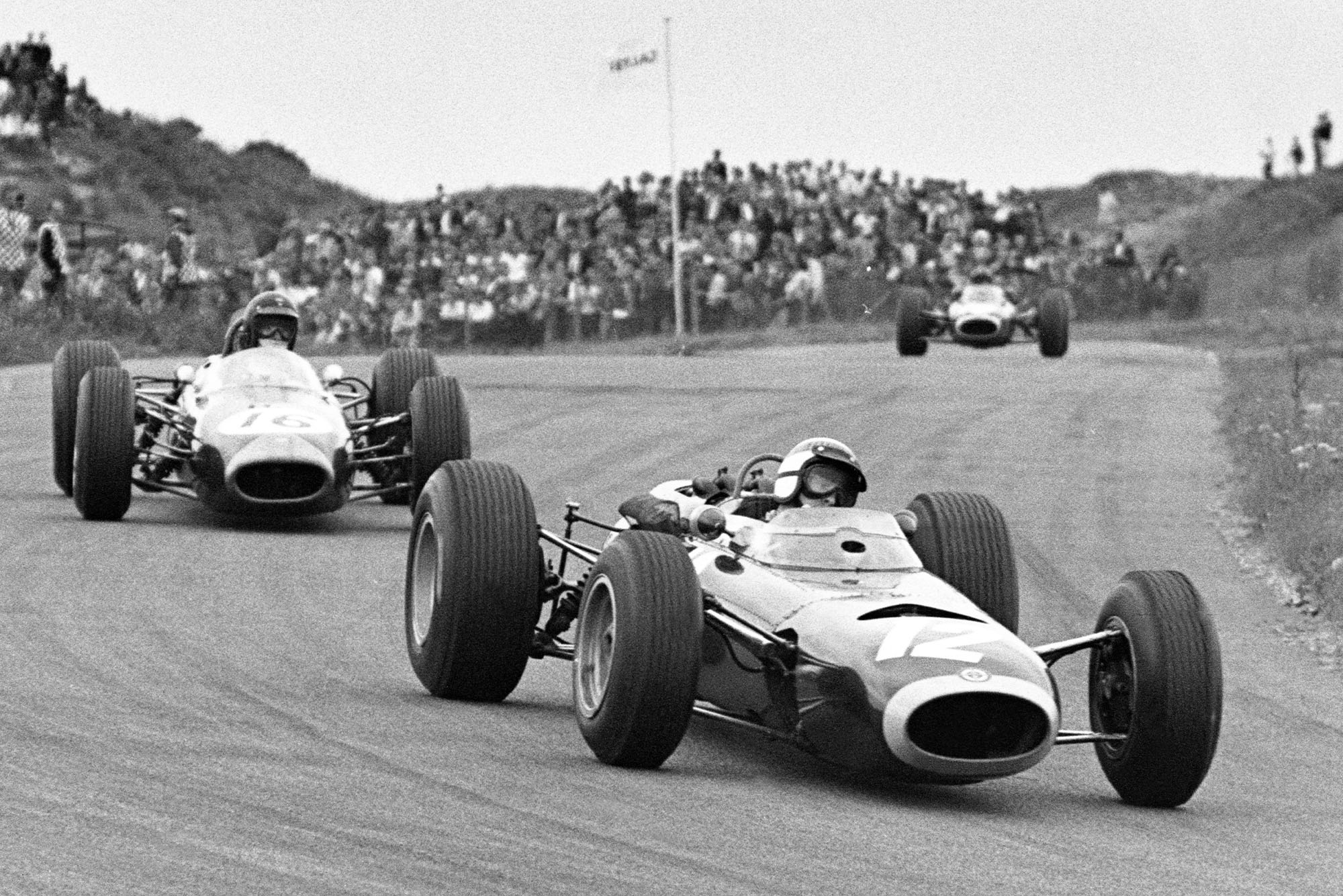 Jackie Stewart, BRM P261, leads Dan Gurney, Brabham BT11 Climax.