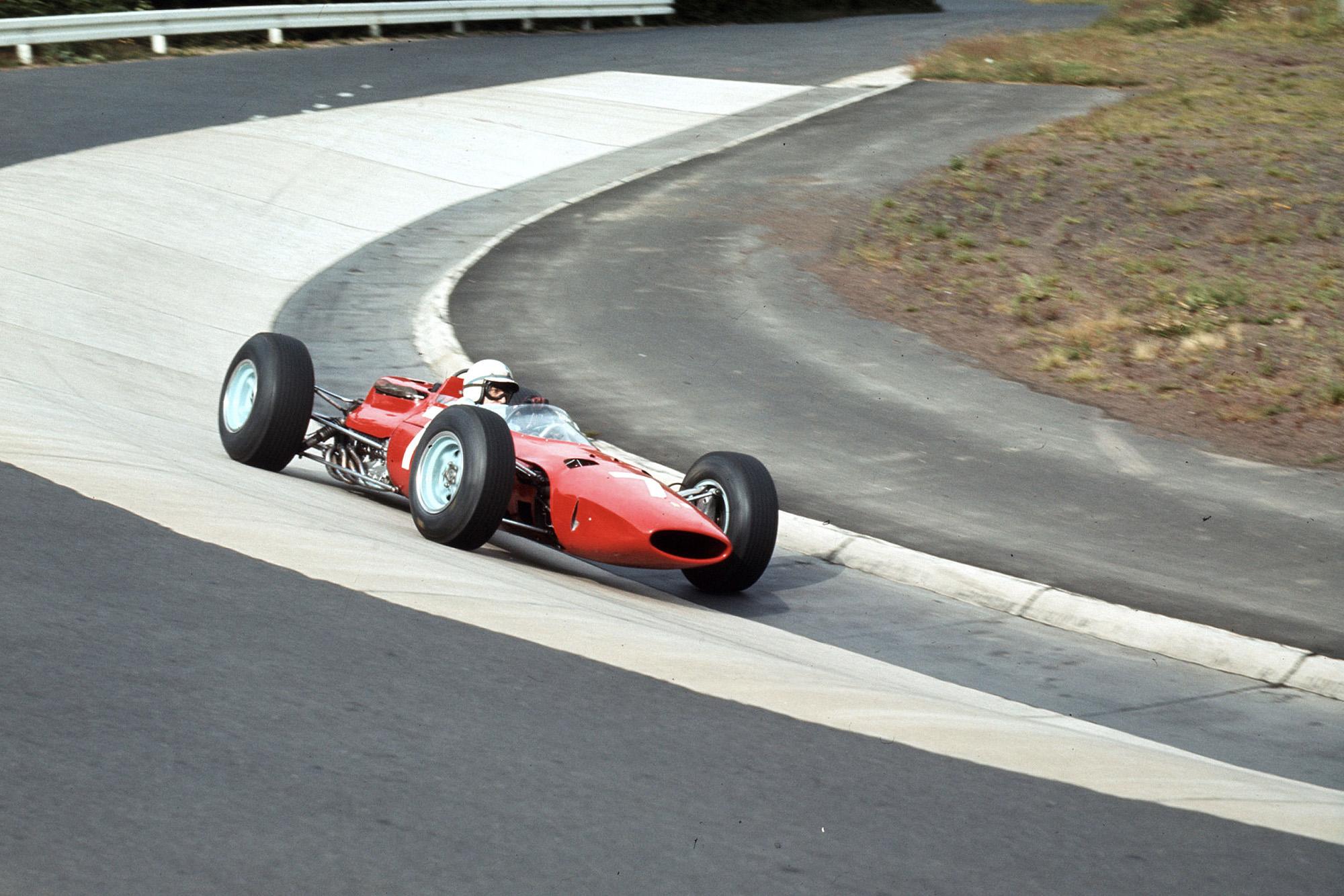 John Surtees (Ferrari 1512) in the Karussel.