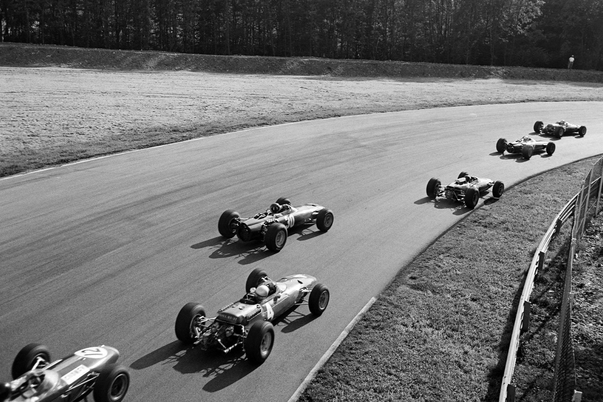 Graham Hill, BRM P261, and Lorenzo Bandini, Ferrari 1512, in the pack.