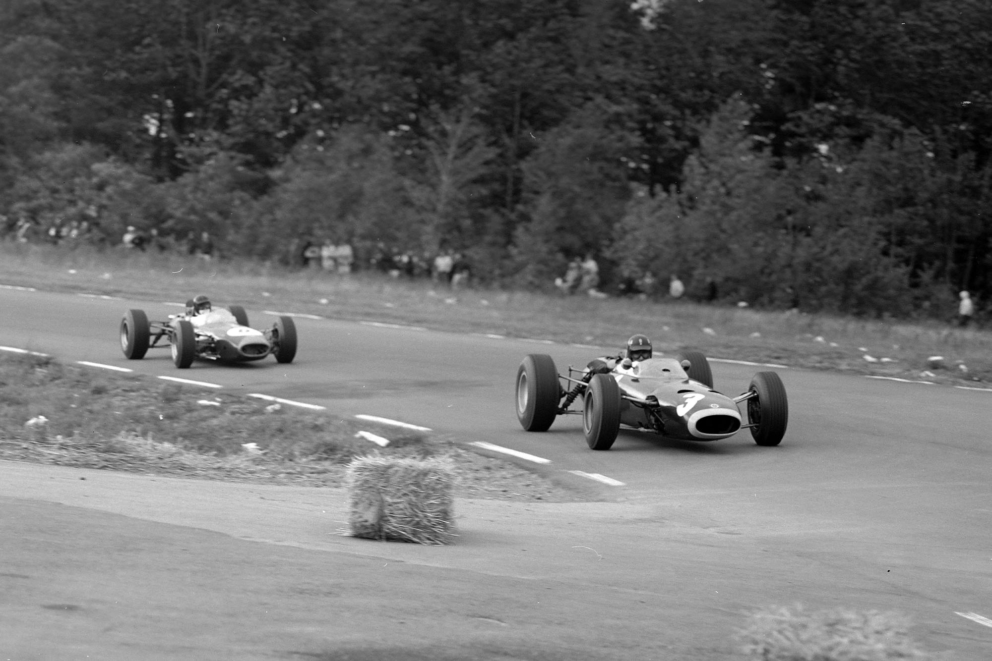 Graham Hill, BRM P261, leads Dan Gurney, Brabham BT11 Climax.