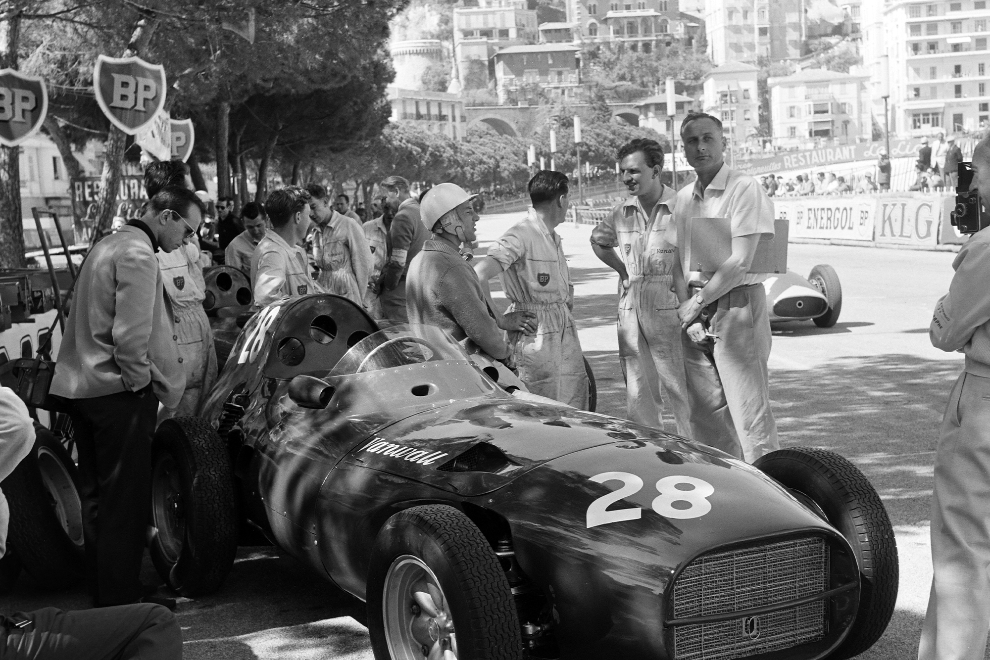 STirling MOss leans on his Vanwall during the 1958 Grand Prix practice.