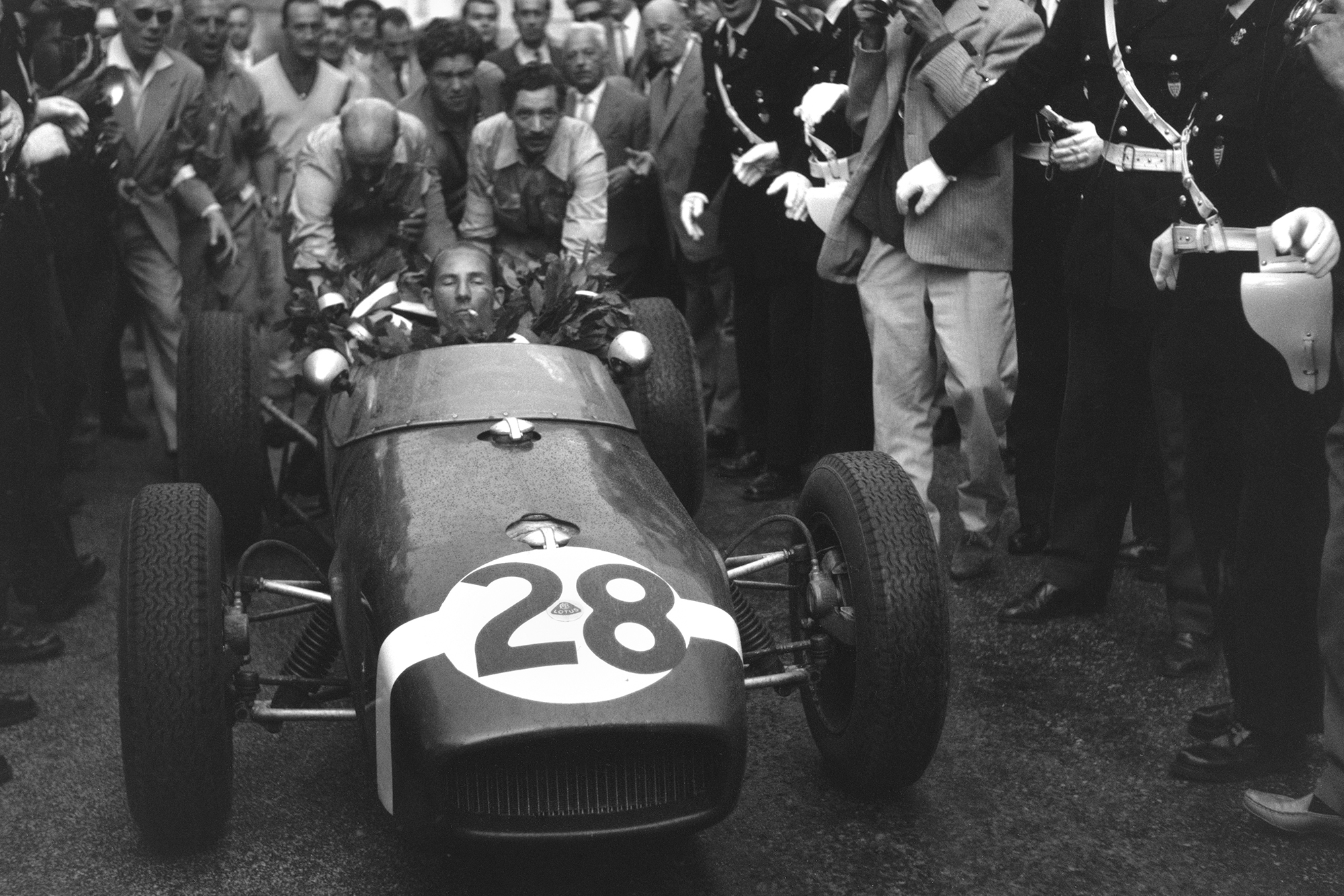 Stirling Moss celebrates victory