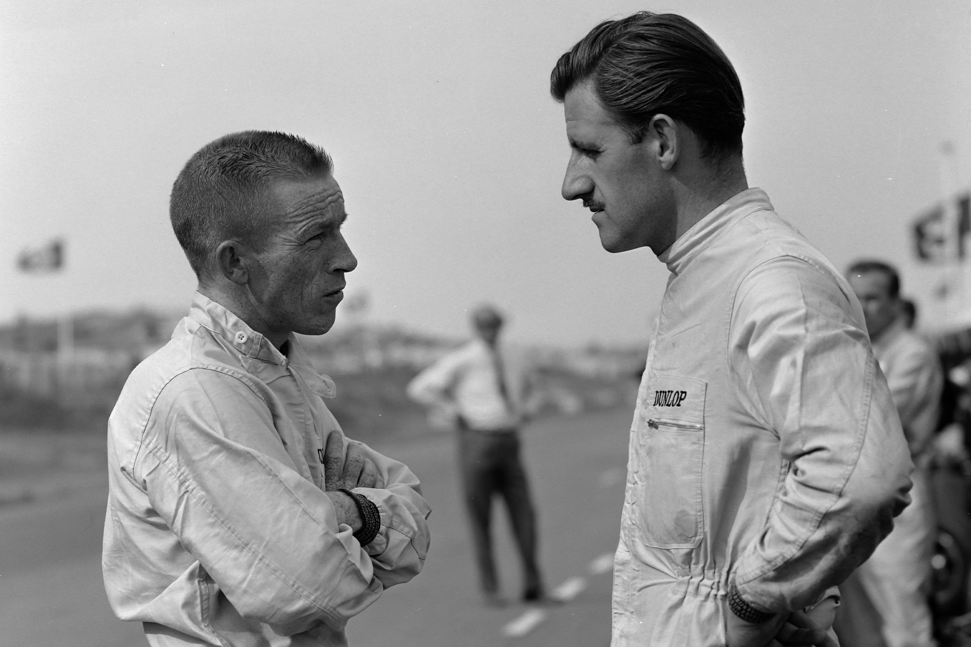 BRM team-mates Ginther and Hill confer.