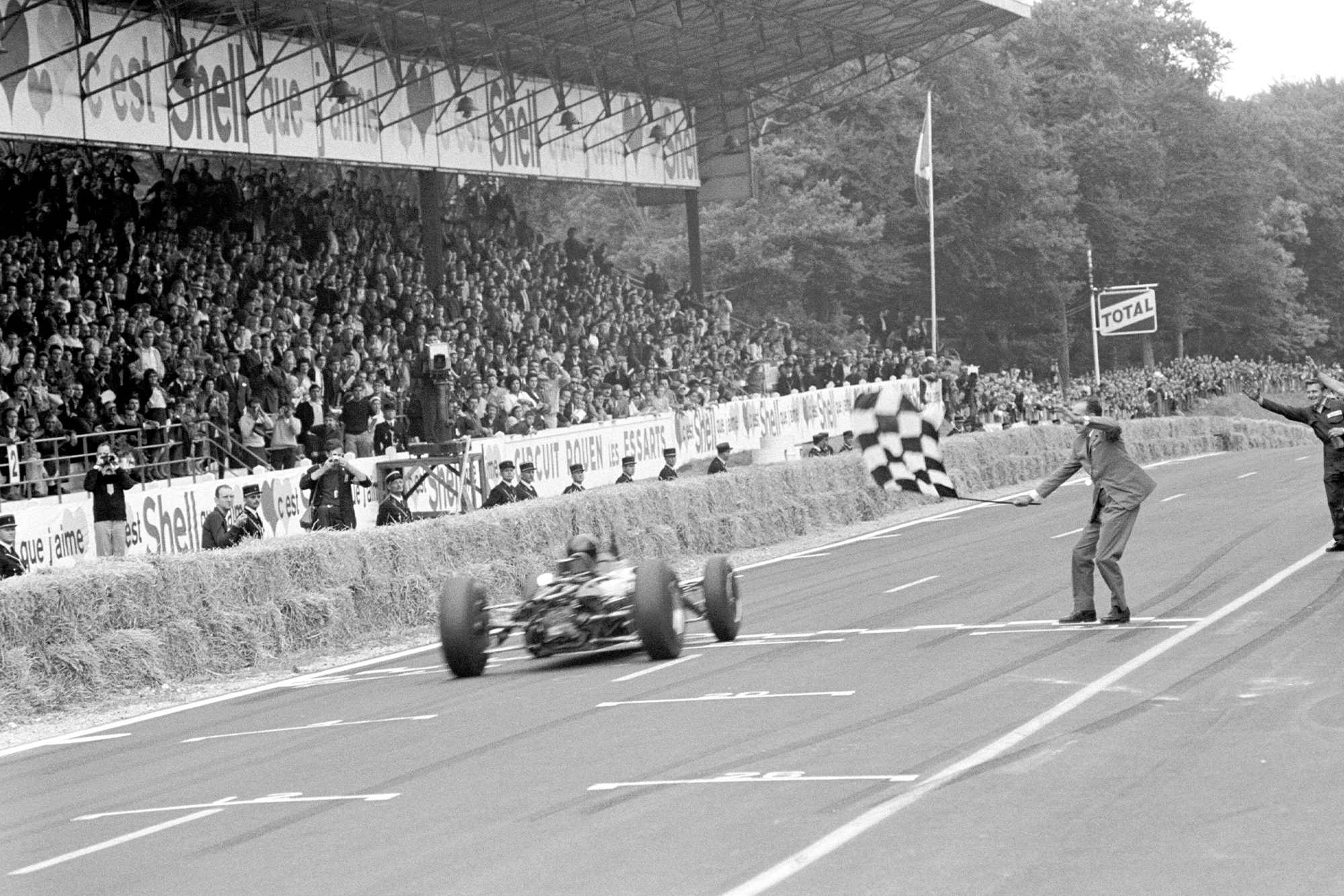 Dan Gurney takes the chequered flag in his Brabham.