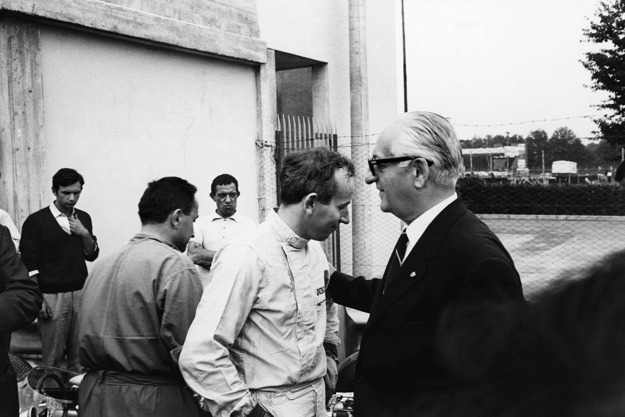 John Surtees with Ferrari team boss Enzo Ferrari talk in the pits.