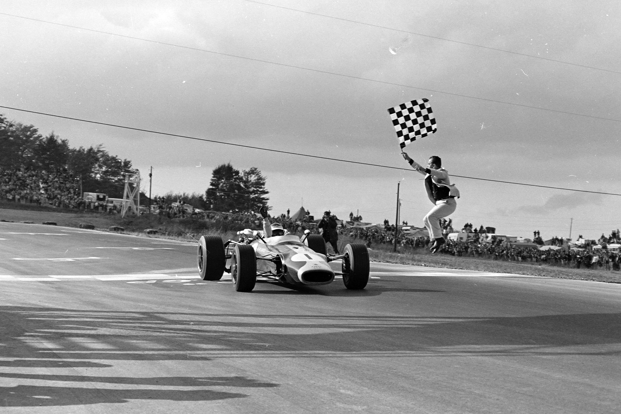 Jim Clark, Lotus 43 BRM takes the chequered flag for victory.