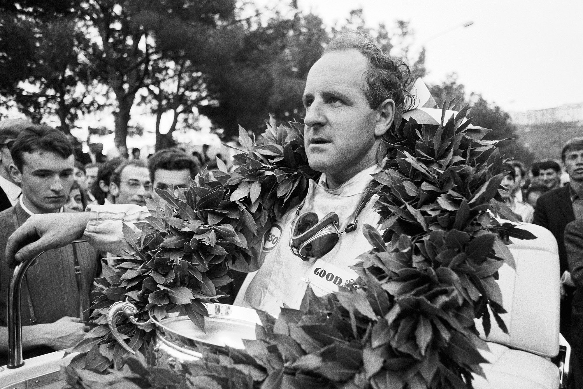 Denny Hulme with the Monaco GP winner's wreath and trophy.