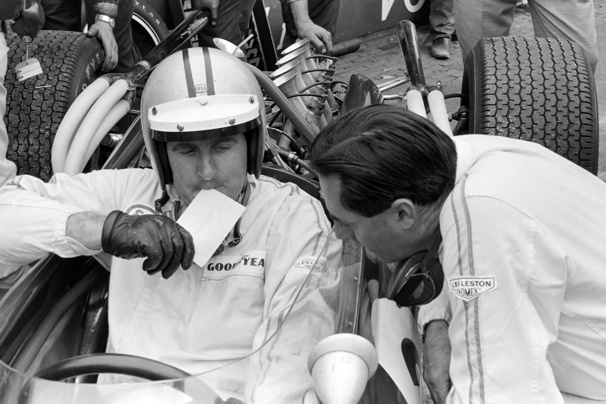 Denny Hulme and Jack Brabham, confer during qualifying.