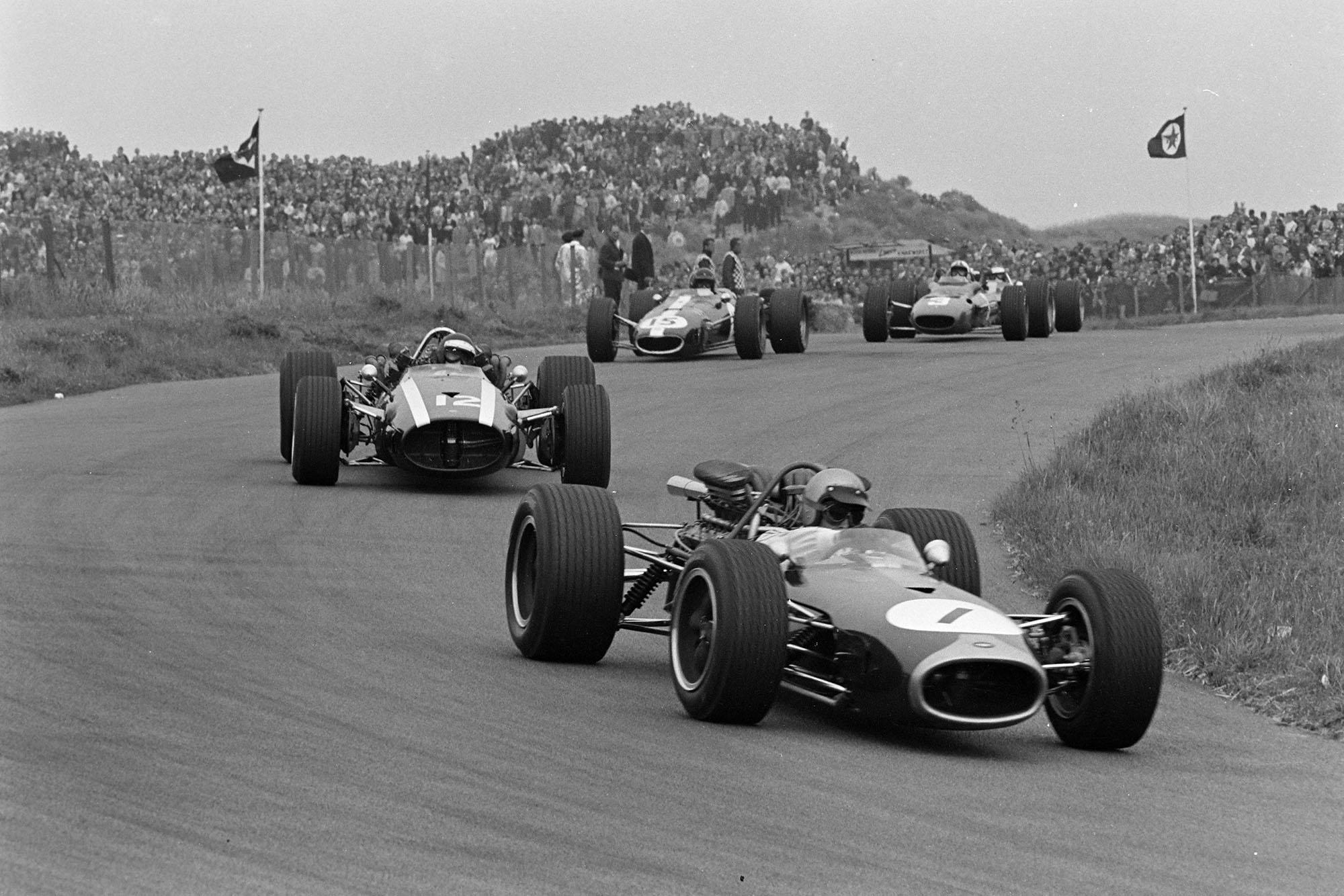 Jack Brabham, Brabham BT19 Repco leads Jochen Rindt, Cooper T81B Maserati and Dan Gurney, Eagle T1G Weslake.