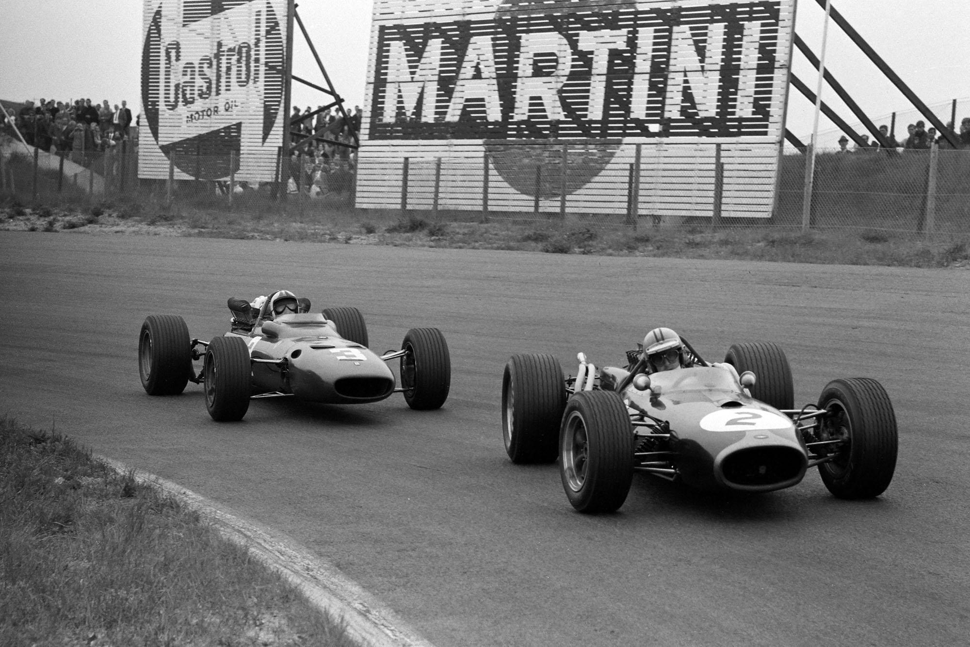 Denny Hulme, Brabham BT20 Repco, leads Chris Amon, Ferrari 312.