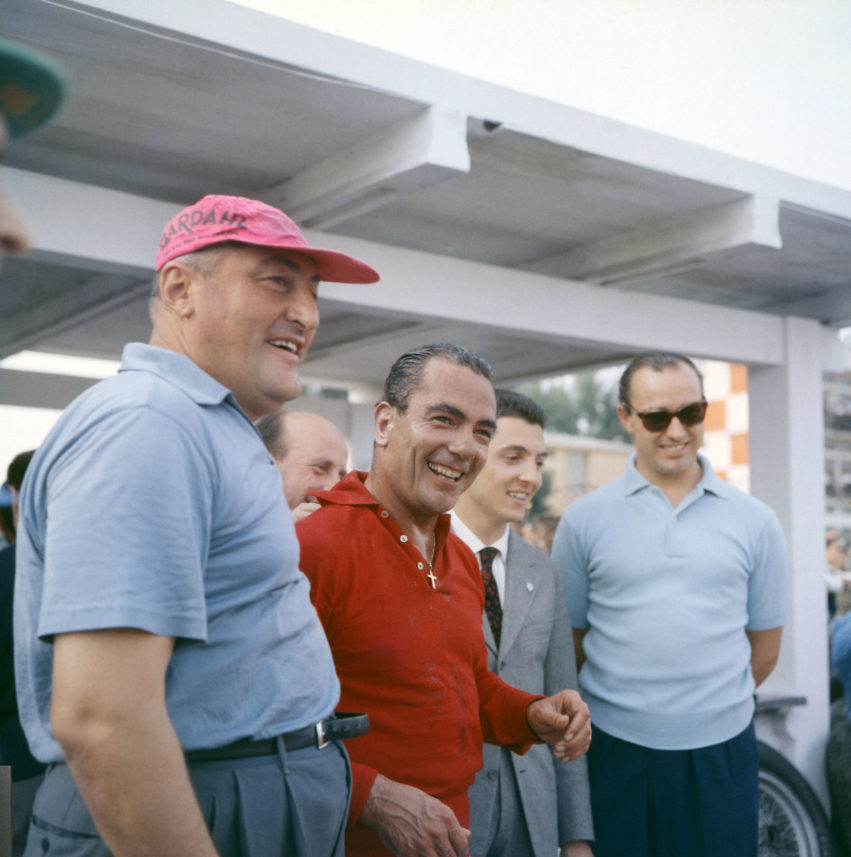 Jean Behra (in red) pictured in1957 at the Grand Prix