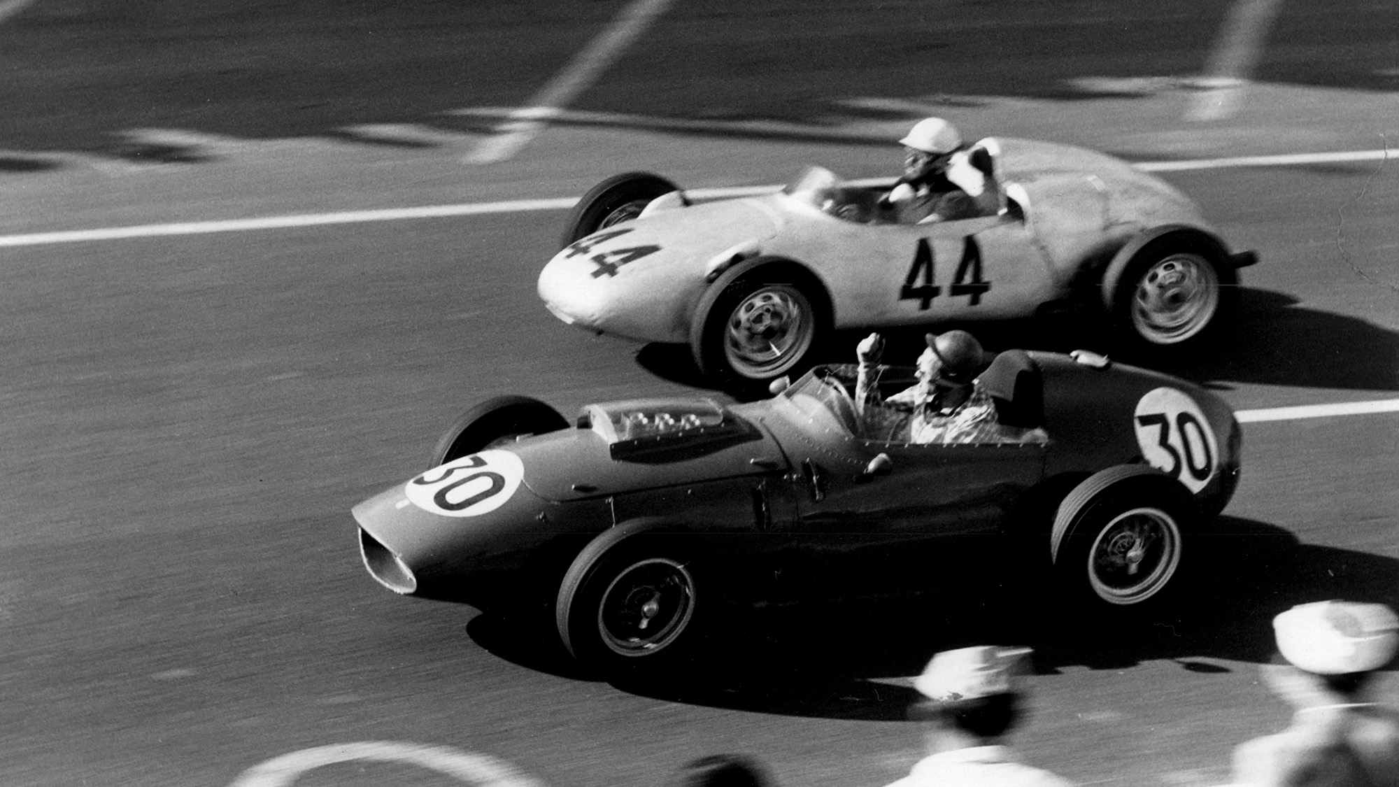 Jean Behra passes Ron Flockhart in the 1959 French Grand Prix