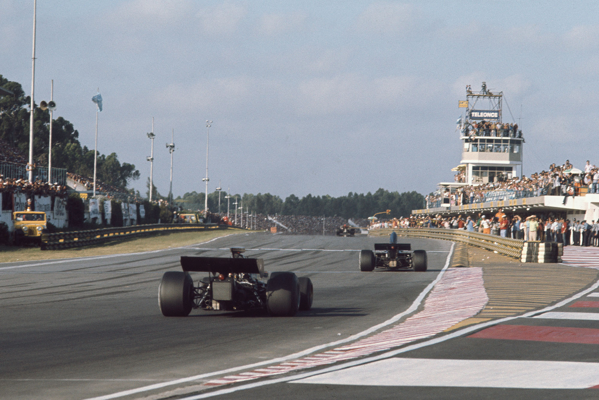 Fittipaldi chases down Cevert.