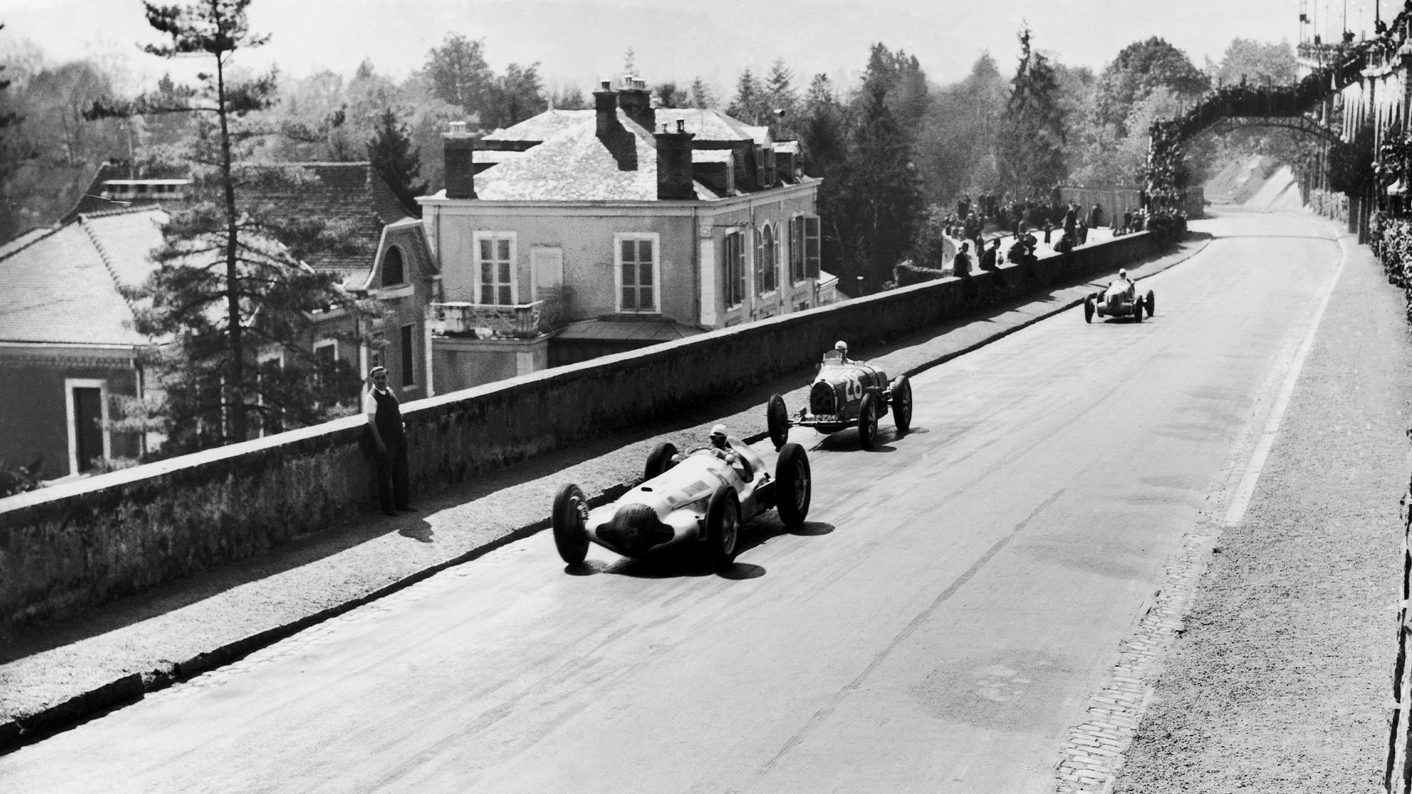 FRANCE - APRIL 11: On April 11, 1938 On The Racing Circuit Of The Grand Prix De Pau, The Mercedes-Benz W154 Piloted By Rudolf Caracciola (Number 6) Followed By Maurice Trintignant'S Bugatti T35-51 Runs Down A Straight Line At Full Speed. (Photo by Keystone-France/Gamma-Keystone via Getty Images)