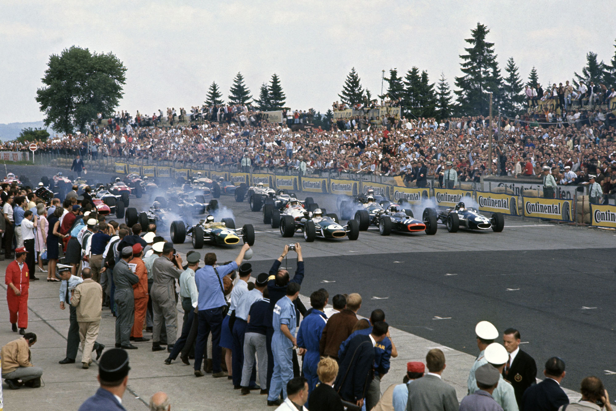 1967 German Grand Prix.Nurburgring, Germany. 6 August 1967.Jim Clark (Lotus 49-Ford Cosworth), Denny Hulme (Brabham BT24-Repco), Jackie Stewart (BRM P83) and Dan Gurney (Eagle T1G-Weslake) on the front row.