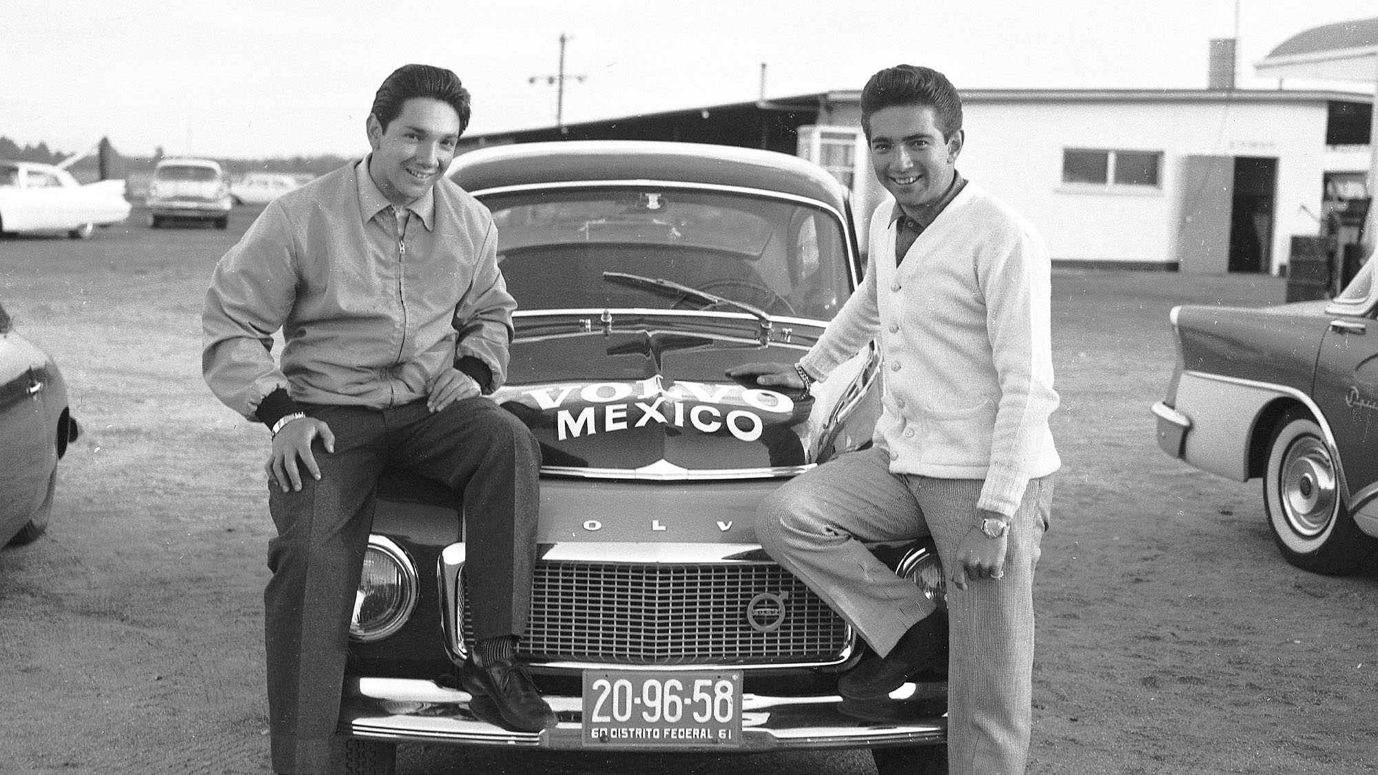 DAYTONA BEACH, FL - JANUARY 25, 1960: Brothers Pedro (L) and Ricardo Rodriguez (R) with the Volvo of Mexico entry for the twin Compact Car races that were held at Daytona International Speedway on January 31, 1960. Pedro actually drove the Volvo in the races, while Ricardo was behind the wheel of a Chevrolet Corvair. (Photo by ISC Images & Archives via Getty Images)