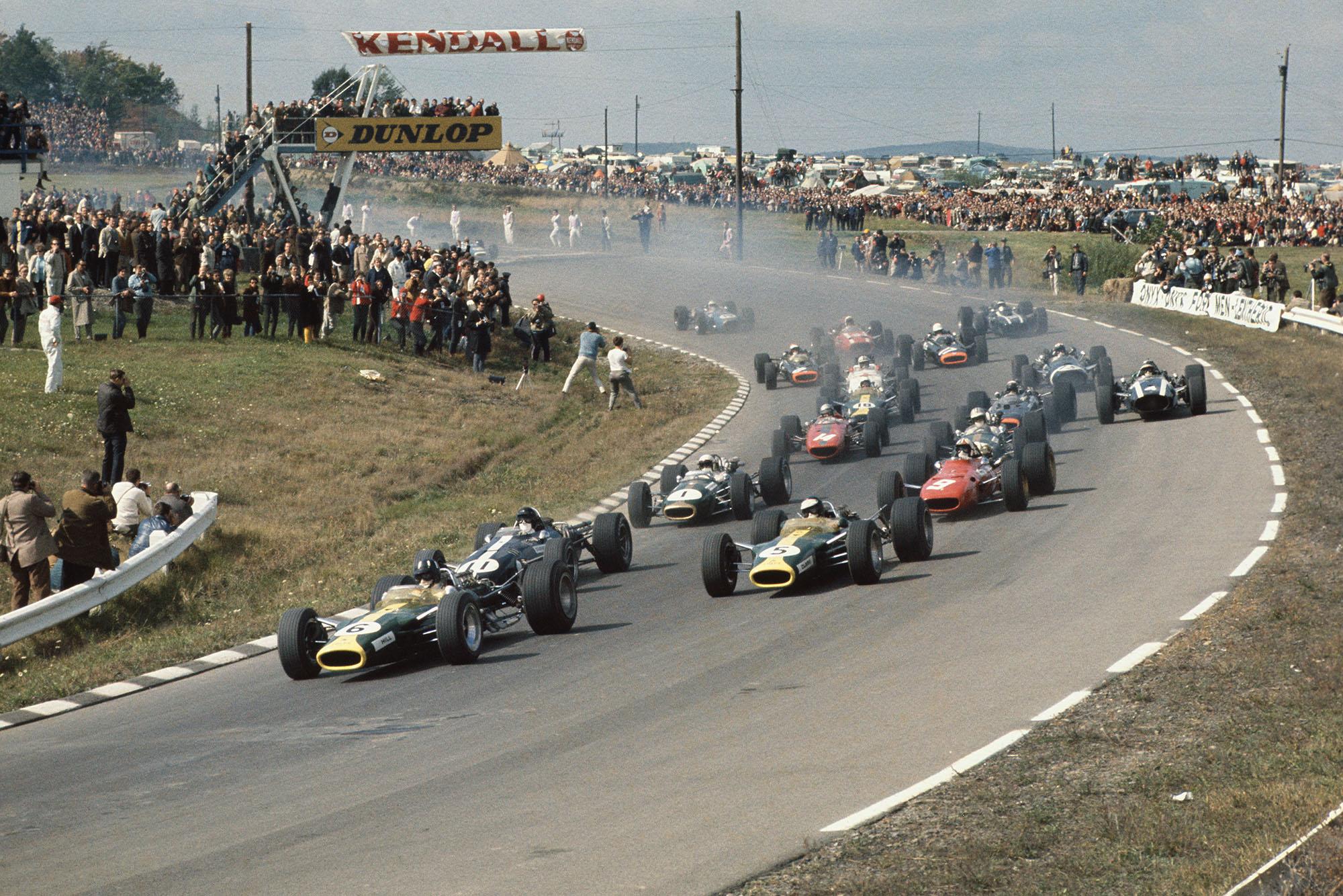 Watkins Glen, New York, USA. 30/9-1/10 1967. .At the start Graham Hill (Lotus 49 Ford) leads from Dan Gurney (Eagle T1G Weslake), Jim Clark (Lotus 49 Ford), Chris Amon (Ferrari 312), Jack Brabham and Denny Hulme (Brabham BT24-Repco), Bruce McLaren (McLaren M5A BRM), Jackie Stewart, Jochen Rindt, Moises Solana, Jo Siffert, John Surtees, Mike Spence, Chris Irwin, Jo Bonnier, Jacky Ickx, Guy Ligier and Jean-Pierre Beltoise.
