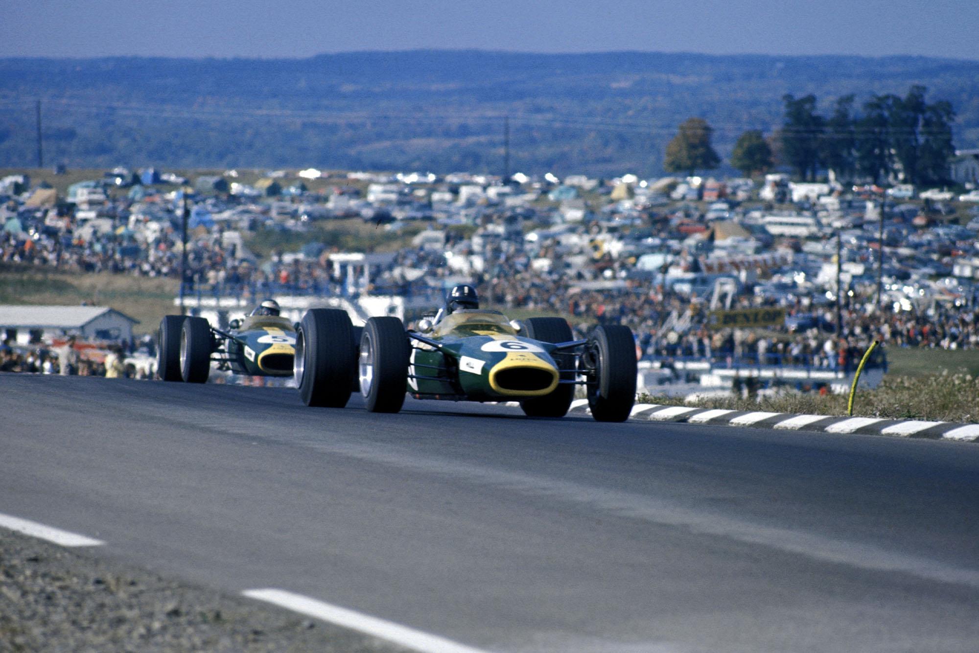 Graham Hill (GBR) Lotus Ford 49, leads team mate Jim Clark (GBR). Formula One World Championship, Rd10, United States Grand Prix, Watkins Glen, USA. 1 October 1967.