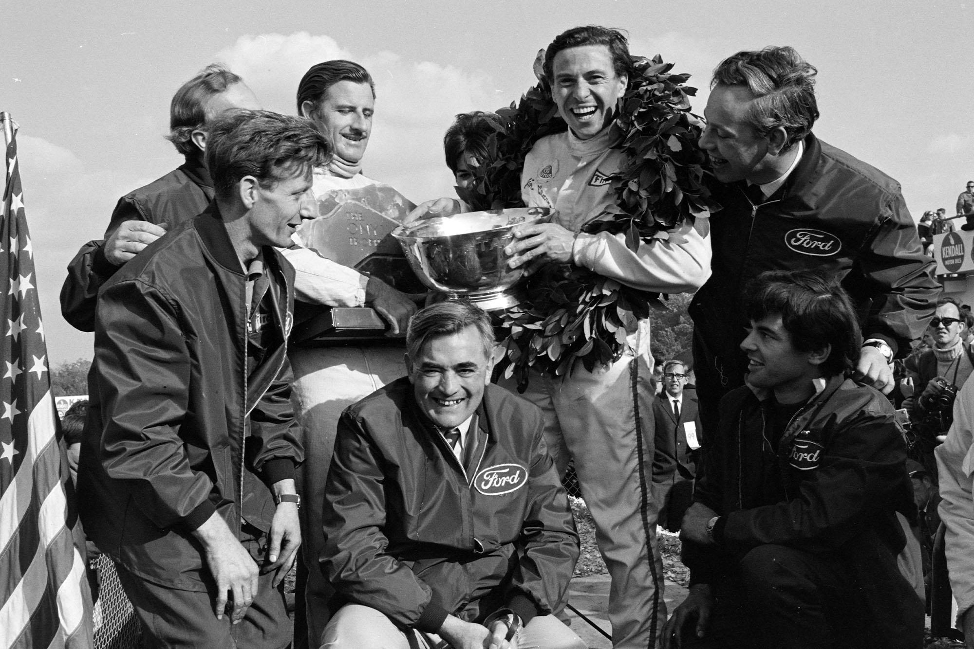 The Lotus team celebrate on the podium