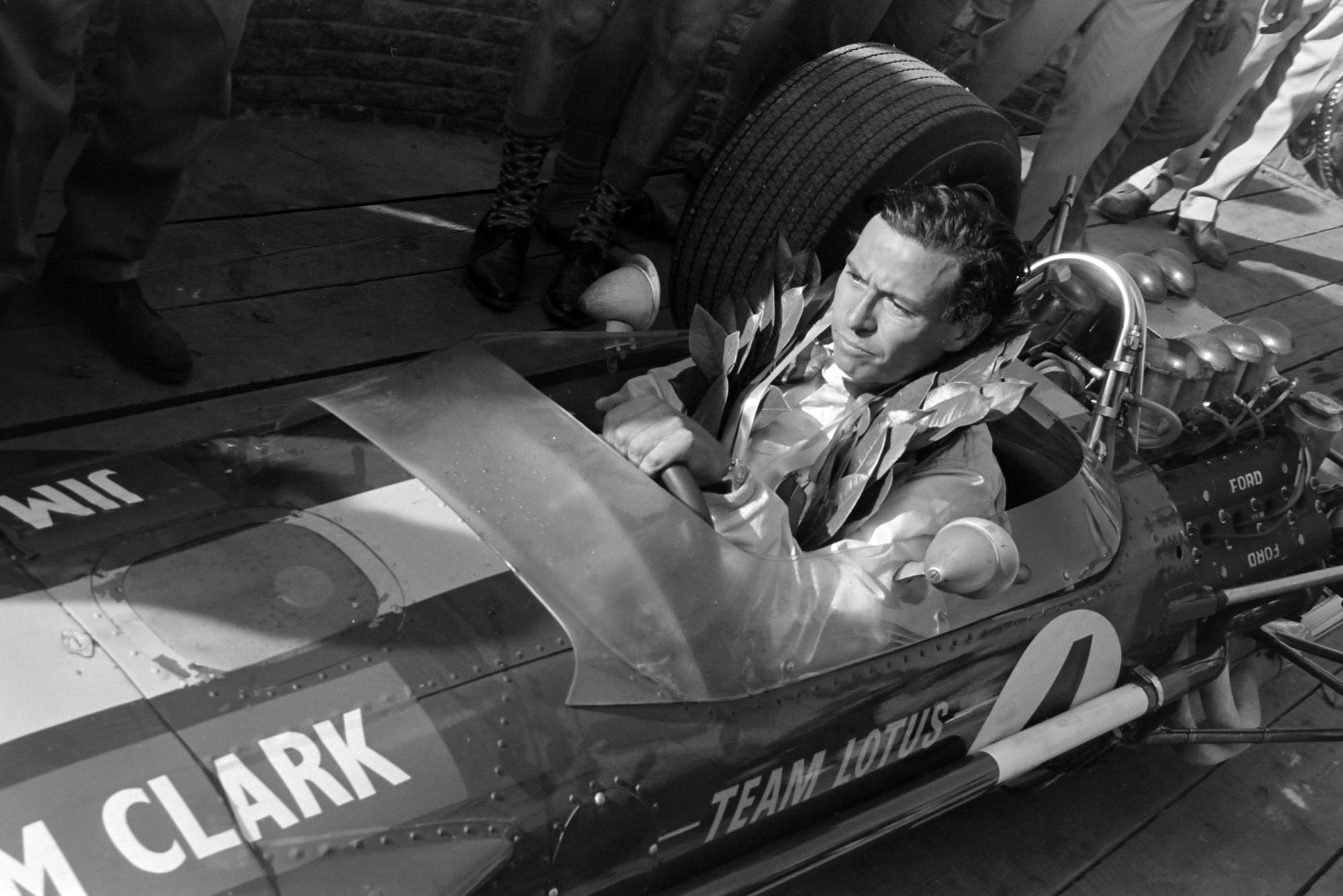 Winner Jim Clark in his Lotus 49 Ford returns to the pits.