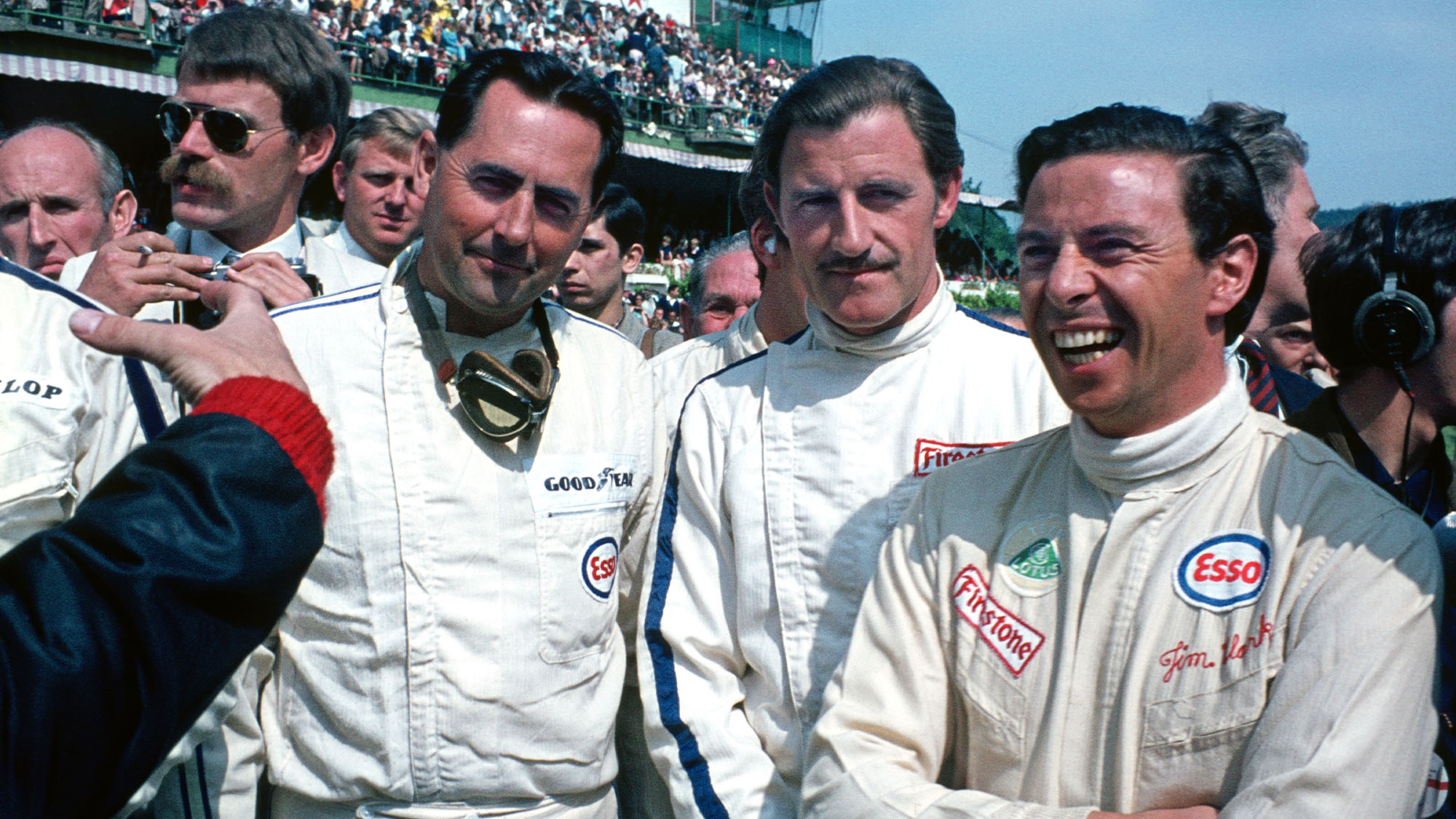 Jack Brabham (Brabham-Repco), Graham Hill () and Jim Clark (borh Lotus-Ford) before the 1967 Belgian Grand Prix in Spa-Francorchamps. Photo: Grand Prix Photo