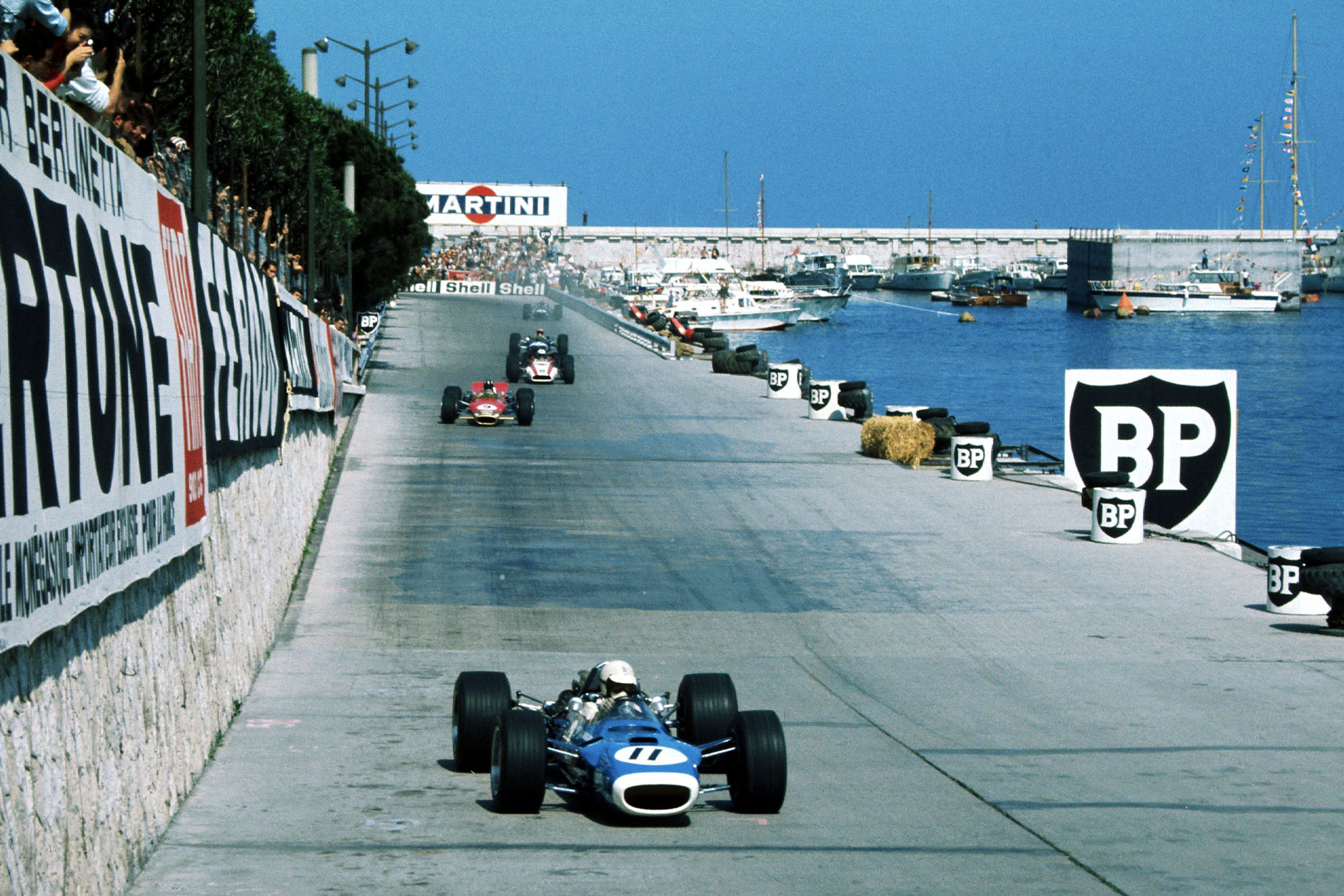 Johnny Servoz-Gavin (FRA), Matra Ford MS10, retired on lap 3 with halfshaft failure. Eventual race winner Graham Hill (GBR), Lotus Ford 49B, is in the background.