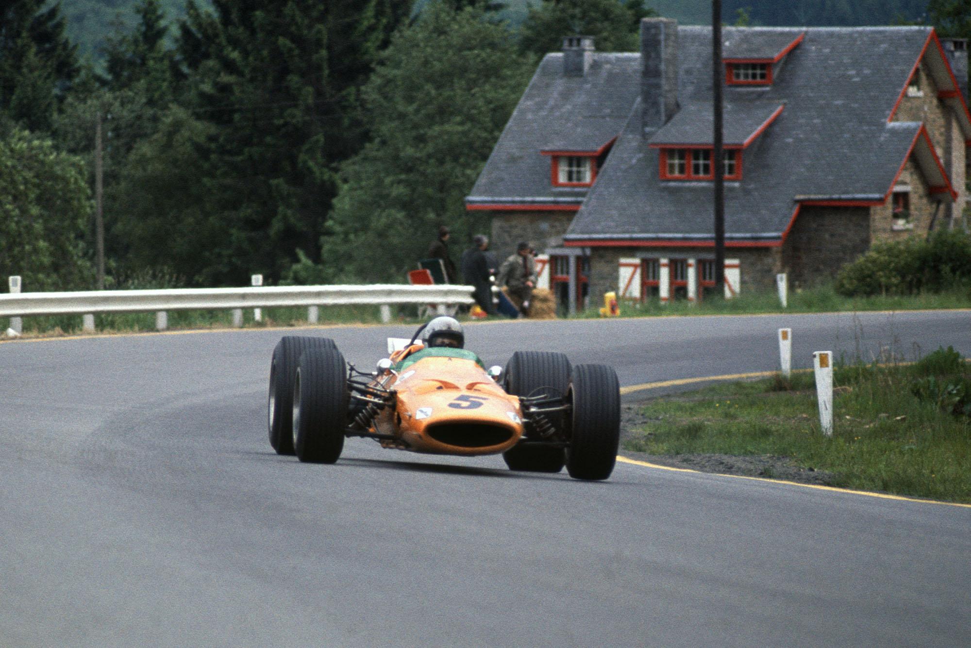 Bruce McLaren (McLaren M7A Ford) 1st position. This was the McLaren constructors maiden Grand Prix win.