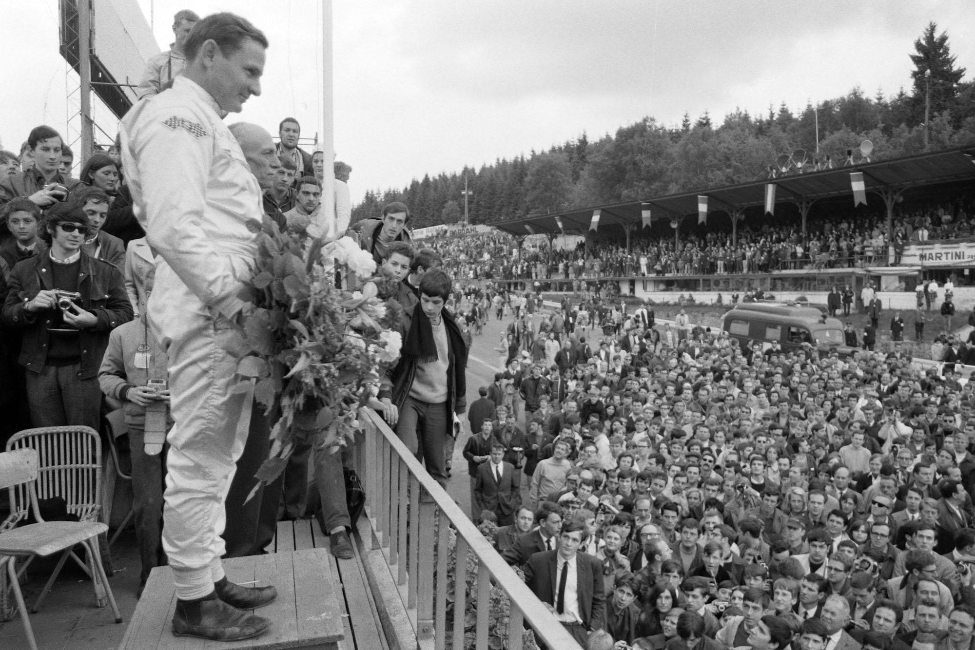 Bruce McLaren, 1st position, on the podium.