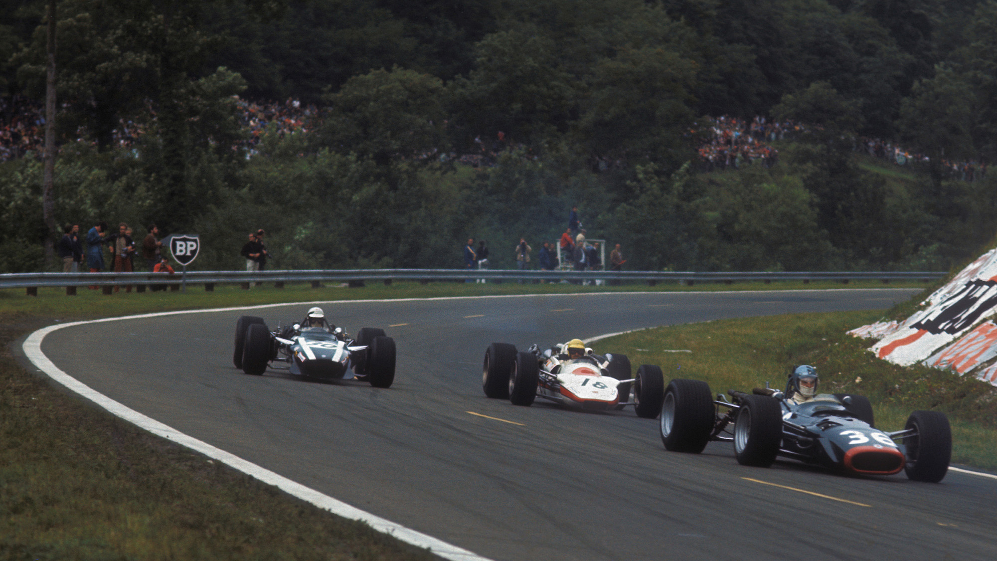 Jo Schlesser Piers Courage and Vic elfors on the opening lap of the 1968 French Grand Prix at Rouen les Essarts