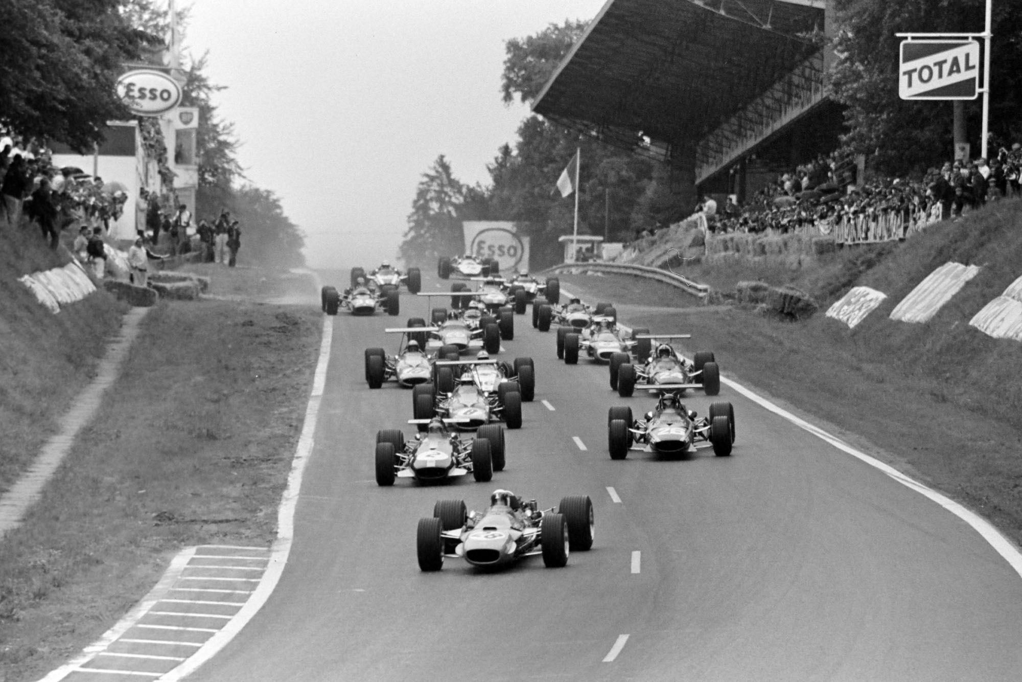 Jackie Stewart, Matra MS10 Ford, leads Jochen Rindt, Brabham BT26 Repco, and Jacky Ickx, Ferrari 312, at the start of the race.