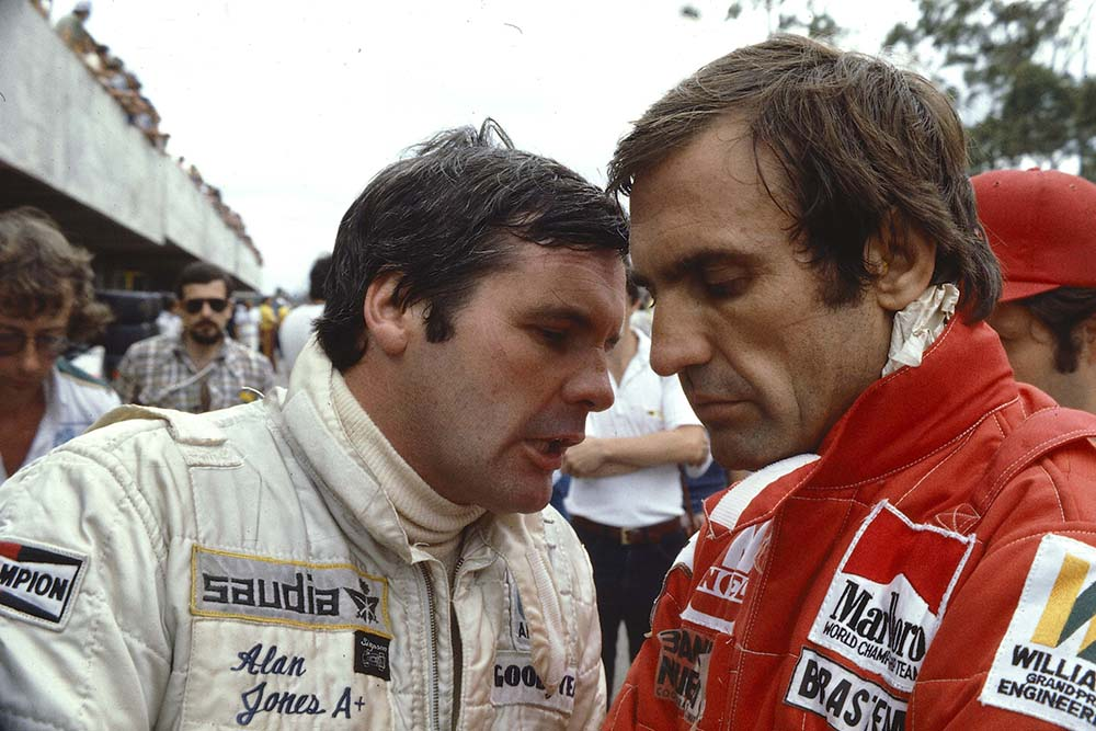 Alan Jones chats with team mate Carlos Reutemann (Both Williams Ford).