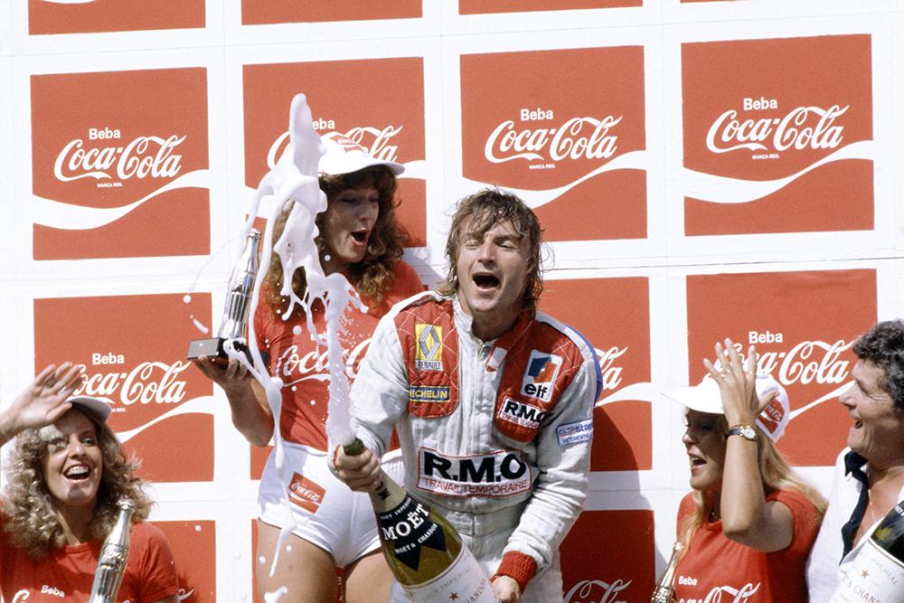 Rene Arnoux (Renault RE20) on the Podium after winning.