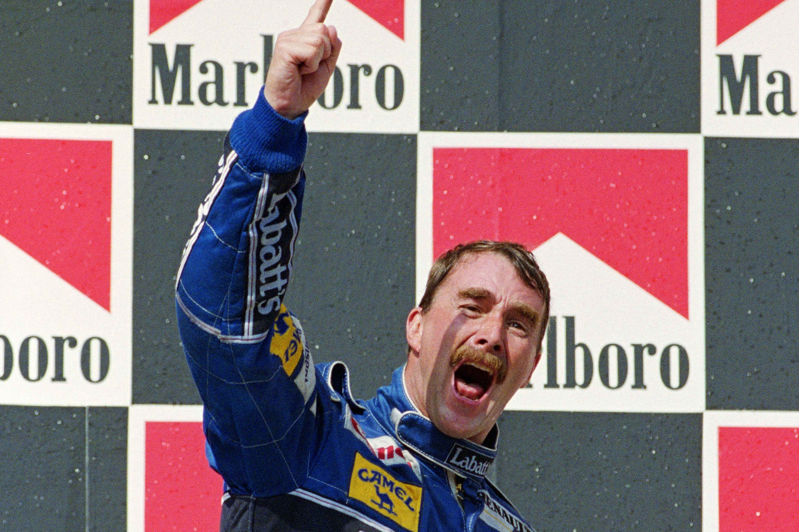 Nigel-Mansell-celebrates-clinching-the-1992-F1-drivers-championship-at-the-Hungarian-Grand-prix