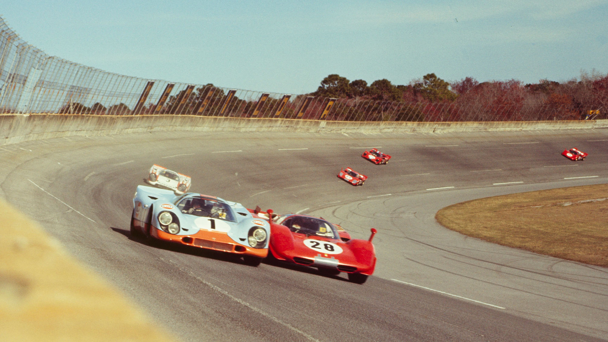 UNITED STATES - FEBRUARY 02: Daytona 24 Hour Race - 1970. Jo Siffert; Brian Redman drive their J.W Engineering Gulf Porsche 917 K against Mario Andretti; Arturo Merzario; Jacky Ickx in their Ferrari 512 S. (Photo by The Enthusiast Network via Getty Images/Getty Images)