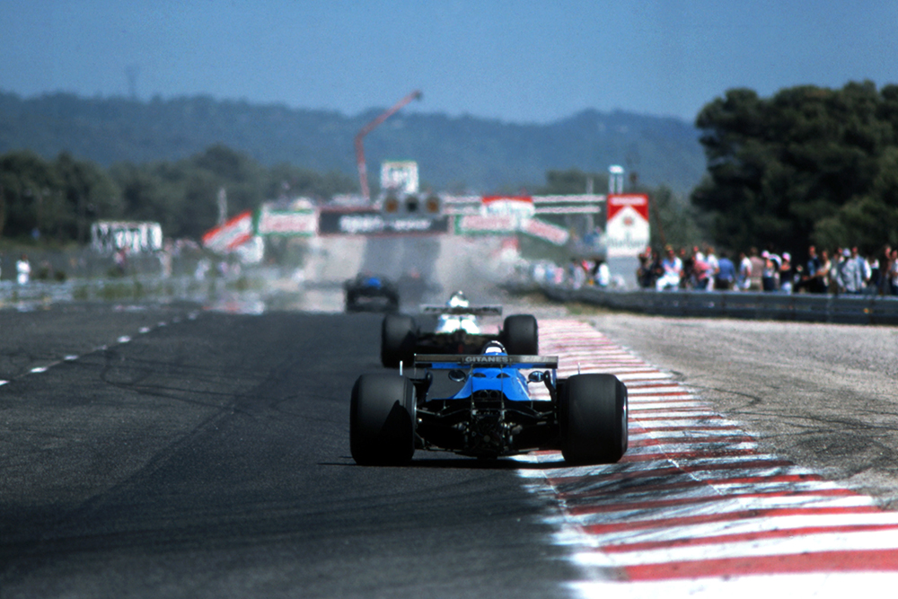 Didier Pironi in his Ligier JS11/15 chases Alan Jones in a Williams FW07B and leader Jacques Laffite Ligier JS11/15.
